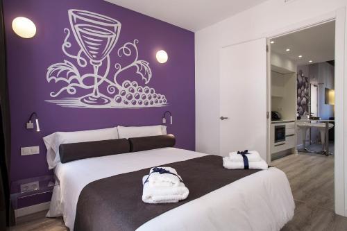 Una cama o camas en una habitación de Habitat Apartments ADN