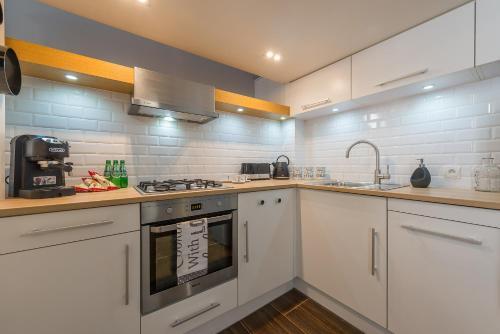 A cozinha ou cozinha compacta de Apartament Conforte Old Town