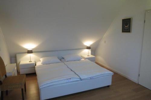 מיטה או מיטות בחדר ב-Wetterkantwoning