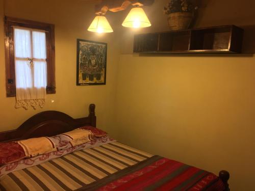Una cama o camas en una habitación de La Pirquita