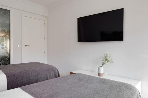 سرير أو أسرّة في غرفة في Soroa Apartment