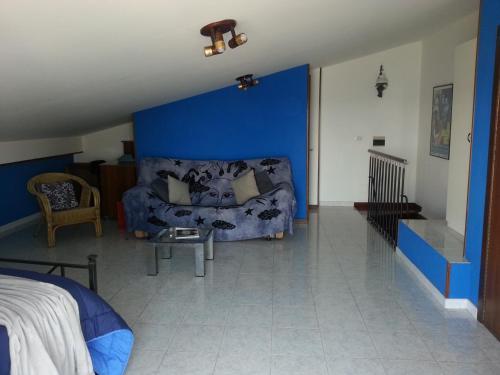 Khu vực ghế ngồi tại Panoramico appartamento sullo Stretto di Messina
