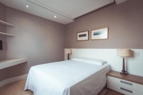 Cama ou camas em um quarto em Flat aconchegante (Barra)