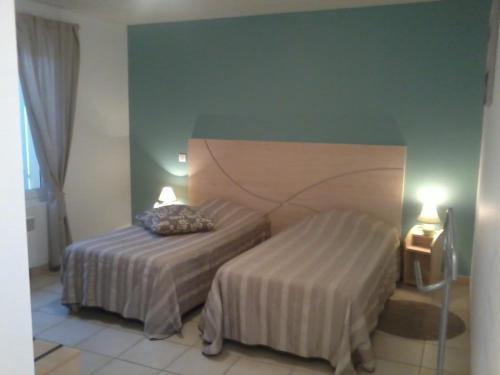 מיטה או מיטות בחדר ב-Au Coeur Des Landes