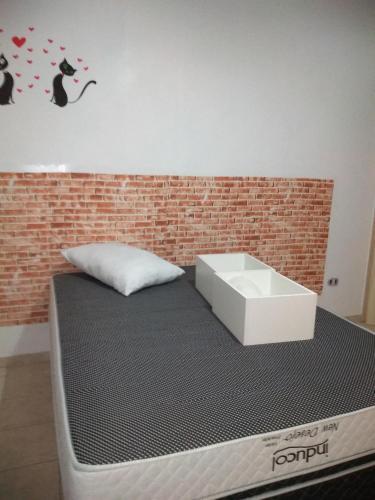 Cama ou camas em um quarto em Apartamento São Vicente