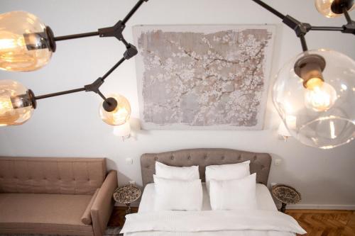 מיטה או מיטות בחדר ב-Centara Brasov