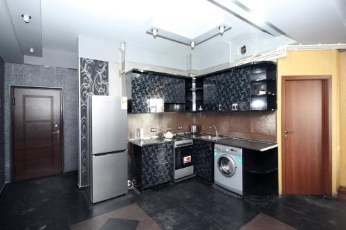 Nhà bếp/bếp nhỏ tại Large apartment in the city center.