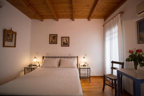 מיטה או מיטות בחדר ב-Nostos Hotel