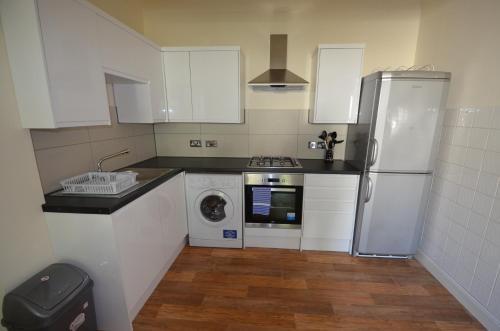 مطبخ أو مطبخ صغير في Central Comfort Apartments