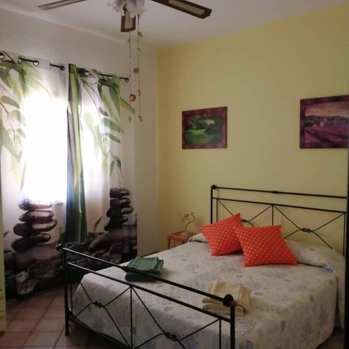 سرير أو أسرّة في غرفة في Affittacamere D&D