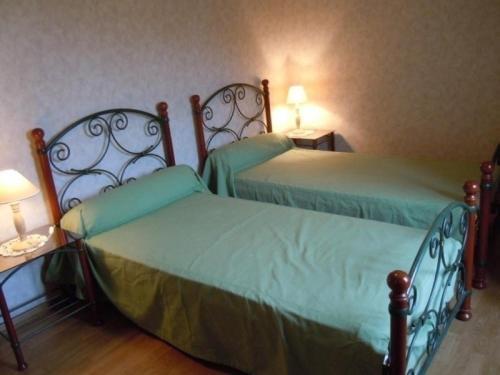Una cama o camas en una habitación de House Lou sécadou 3