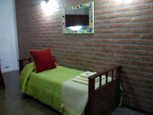 Una cama o camas en una habitación de El Chinchero