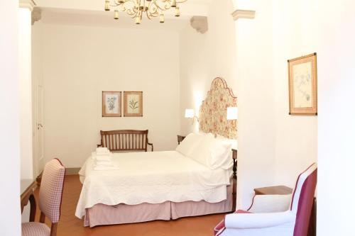 Una cama o camas en una habitación de BorgoDeiGreci Apartments
