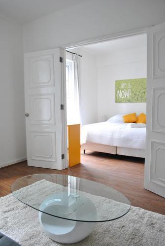 Cama ou camas em um quarto em CLH Suites Santiago