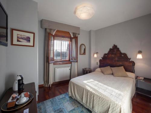 מיטה או מיטות בחדר ב-Almunia de San Miguel