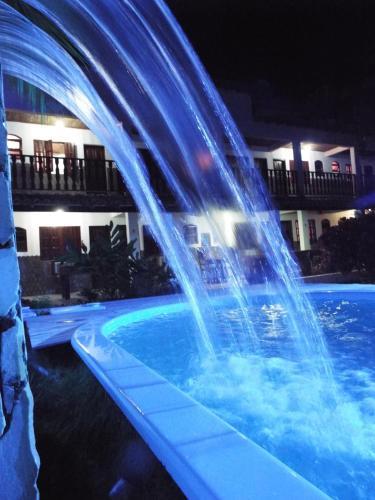 A piscina localizada em Pousada Alfa ou nos arredores