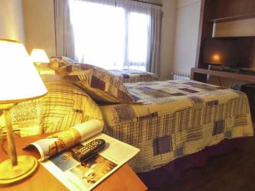 מיטה או מיטות בחדר ב-Nexos Bariloche