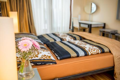 Cama ou camas em um quarto em River Diamond Luxury Apartments