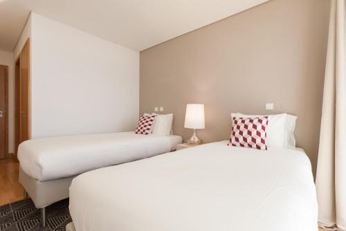 Cama ou camas em um quarto em Your Lisbon Home Oriente