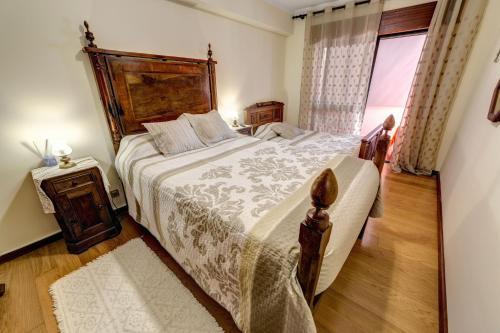 מיטה או מיטות בחדר ב-Bragança Apartments