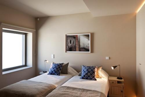 Una cama o camas en una habitación de Foz Loft by the Sea