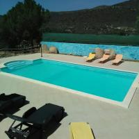 villa with swimming pool and tennis camp