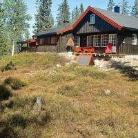 Four-Bedroom Holiday home in Løten