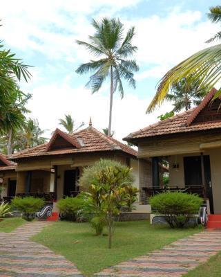 Maadathil Cottages