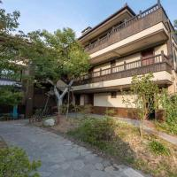 Shanqiutian Leisure Guesthouse </h2 <div class=sr-card__item sr-card__item--badges <div style=padding: 2px 0    </div </div <div class=sr-card__item   data-ga-track=click data-ga-category=SR Card Click data-ga-action=Hotel location data-ga-label=book_window:  day(s)  <svg alt=Property location  class=bk-icon -iconset-geo_pin sr_svg__card_icon height=12 width=12<use xlink:href=#icon-iconset-geo_pin</use</svg <div class= sr-card__item__content   <strong class='sr-card__item--strong'Wuxi</strong • <span 8.1 miles </span  from Guzhu </div </div </div </div </a </li <div data-et-view=cJaQWPWNEQEDSVWe:1</div <li id=hotel_5040802 data-is-in-favourites=0 data-hotel-id='5040802' class=sr-card sr-card--arrow bui-card bui-u-bleed@small js-sr-card m_sr_info_icons card-halved card-halved--active   <a href=/hotel/cn/crowne-plaza-wuxi-lake-view.en-gb.html target=_blank class=sr-card__row bui-card__content data-et-click=customGoal: aria-label=  Crowne Plaza Wuxi Lake View,      <div class=sr-card__image js-sr_simple_card_hotel_image has-debolded-deal js-lazy-image sr-card__image--lazy data-src=https://q-ec.bstatic.com/xdata/images/hotel/square200/199195899.jpg?k=9ae77b095e349df260dcb3dc975f73969cee740a0010c513ec9db11f9846db8a&o=&s=1,https://q-ec.bstatic.com/xdata/images/hotel/max1024x768/199195899.jpg?k=f6e12cac902539e02eba86602e84499bc913d8a5b13ae46d53182c892026d7ec&o=&s=1  <div class=sr-card__image-inner css-loading-hidden </div <noscript <div class=sr-card__image--nojs style=background-image: url('https://q-ec.bstatic.com/xdata/images/hotel/square200/199195899.jpg?k=9ae77b095e349df260dcb3dc975f73969cee740a0010c513ec9db11f9846db8a&o=&s=1')</div </noscript </div <div class=sr-card__details data-et-click=     <div class=sr-card_details__inner <h2 class=sr-card__name u-margin:0 u-padding:0 data-ga-track=click data-ga-category=SR Card Click data-ga-action=Hotel name data-ga-label=book_window:  day(s)  Crowne Plaza Wuxi Lake View </h2 <div class=sr-card__item sr-card__item--badges <div style=padding: 2px 0    </div </div <div class=sr-card__item   data-ga-track=click data-ga-category=SR Card Click data-ga-action=Hotel location data-ga-label=book_window:  day(s)  <svg alt=Property location  class=bk-icon -iconset-geo_pin sr_svg__card_icon height=12 width=12<use xlink:href=#icon-iconset-geo_pin</use</svg <div class= sr-card__item__content   <strong class='sr-card__item--strong'Wuxi</strong • <span 8.7 miles </span  from Guzhu </div </div </div </div </a </li <div data-et-view=cJaQWPWNEQEDSVWe:1</div <li id=hotel_2463076 data-is-in-favourites=0 data-hotel-id='2463076' class=sr-card sr-card--arrow bui-card bui-u-bleed@small js-sr-card m_sr_info_icons card-halved card-halved--active   <a href=/hotel/cn/wu-xi-tai-hu-fan-dian.en-gb.html target=_blank class=sr-card__row bui-card__content data-et-click=customGoal: aria-label=  Wuxi Taihu Hotel,  Scored 9.2 ,      <div class=sr-card__image js-sr_simple_card_hotel_image has-debolded-deal js-lazy-image sr-card__image--lazy data-src=https://q-ec.bstatic.com/xdata/images/hotel/square200/130235108.jpg?k=c4fc2680ba9e42f50a11a6e96c1f806de1197a2737352492d620d4e7fe226e0f&o=&s=1,https://r-ec.bstatic.com/xdata/images/hotel/max1024x768/130235108.jpg?k=2d05e0b9130d1e8aa354e157d525bdac9f1a58982d20e6dde5195705370525ac&o=&s=1  <div class=sr-card__image-inner css-loading-hidden </div <noscript <div class=sr-card__image--nojs style=background-image: url('https://q-ec.bstatic.com/xdata/images/hotel/square200/130235108.jpg?k=c4fc2680ba9e42f50a11a6e96c1f806de1197a2737352492d620d4e7fe226e0f&o=&s=1')</div </noscript </div <div class=sr-card__details data-et-click=     <div class=sr-card_details__inner <h2 class=sr-card__name u-margin:0 u-padding:0 data-ga-track=click data-ga-category=SR Card Click data-ga-action=Hotel name data-ga-label=book_window:  day(s)  Wuxi Taihu Hotel </h2 <div class=sr-card__item sr-card__item--badges <div class= sr-card__badge sr-card__badge--class u-margin:0  data-ga-track=click data-ga-category=SR Card Click data-ga-action=Hotel rating data-ga-label=book_window:  day(s)  <div class=china_stars_categories <i class= bk-icon-wrapper zhcn-ratings  title= <svg aria-hidden=true class=bk-icon -sprite-ratings_circles_5 focusable=false height=10 width=58<use xlink:href=#icon-sprite-ratings_circles_5</use</svg</i </div </div   <div style=padding: 2px 0  <div class=bui-review-score c-score bui-review-score--smaller <div class=bui-review-score__badge aria-label=Scored 9.2  9.2 </div <div class=bui-review-score__content <div class=bui-review-score__title Superb </div </div </div   </div </div <div class=sr-card__item   data-ga-track=click data-ga-category=SR Card Click data-ga-action=Hotel location data-ga-label=book_window:  day(s)  <svg alt=Property location  class=bk-icon -iconset-geo_pin sr_svg__card_icon height=12 width=12<use xlink:href=#icon-iconset-geo_pin</use</svg <div class= sr-card__item__content   <strong class='sr-card__item--strong'Wuxi</strong • <span 8.7 miles </span  from Guzhu </div </div </div </div </a </li <div data-et-view=cJaQWPWNEQEDSVWe:1</div <li id=hotel_1810856 data-is-in-favourites=0 data-hotel-id='1810856' class=sr-card sr-card--arrow bui-card bui-u-bleed@small js-sr-card m_sr_info_icons card-halved card-halved--active   <a href=/hotel/cn/wu-xi-tai-hu-hua-yuan-du-jia-cun-hua-yuan-da-jiu-dian.en-gb.html target=_blank class=sr-card__row bui-card__content data-et-click=customGoal: aria-label=  Lakeview Park Resort,  Scored 8.2 ,      <div class=sr-card__image js-sr_simple_card_hotel_image has-debolded-deal js-lazy-image sr-card__image--lazy data-src=https://q-ec.bstatic.com/xdata/images/hotel/square200/70559516.jpg?k=8ff0d758c5ebde9e1b4d367b52ce0c958e41c1e73b6696b73481ec27de2558d9&o=&s=1,https://q-ec.bstatic.com/xdata/images/hotel/max1024x768/70559516.jpg?k=4c522d88be3a9d7453992156e7aa5b0ffc26907b1f7250230f447a90e8697257&o=&s=1  <div class=sr-card__image-inner css-loading-hidden </div <noscript <div class=sr-card__image--nojs style=background-image: url('https://q-ec.bstatic.com/xdata/images/hotel/square200/70559516.jpg?k=8ff0d758c5ebde9e1b4d367b52ce0c958e41c1e73b6696b73481ec27de2558d9&o=&s=1')</div </noscript </div <div class=sr-card__details data-et-click=     <div class=sr-card_details__inner <h2 class=sr-card__name u-margin:0 u-padding:0 data-ga-track=click data-ga-category=SR Card Click data-ga-action=Hotel name data-ga-label=book_window:  day(s)  Lakeview Park Resort </h2 <div class=sr-card__item sr-card__item--badges <div style=padding: 2px 0  <div class=bui-review-score c-score bui-review-score--smaller <div class=bui-review-score__badge aria-label=Scored 8.2  8.2 </div <div class=bui-review-score__content <div class=bui-review-score__title Very good </div </div </div   </div </div <div class=sr-card__item   data-ga-track=click data-ga-category=SR Card Click data-ga-action=Hotel location data-ga-label=book_window:  day(s)  <svg alt=Property location  class=bk-icon -iconset-geo_pin sr_svg__card_icon height=12 width=12<use xlink:href=#icon-iconset-geo_pin</use</svg <div class= sr-card__item__content   <strong class='sr-card__item--strong'Wuxi</strong • <span 8.7 miles </span  from Guzhu </div </div </div </div </a </li <div data-et-view=cJaQWPWNEQEDSVWe:1</div <li id=hotel_4102826 data-is-in-favourites=0 data-hotel-id='4102826' data-lazy-load-nd class=sr-card sr-card--arrow bui-card bui-u-bleed@small js-sr-card m_sr_info_icons card-halved card-halved--active   <a href=/hotel/cn/wuxi-marriott-lihu-lake.en-gb.html target=_blank class=sr-card__row bui-card__content data-et-click=customGoal: aria-label=  Wuxi Marriott Hotel Lihu Lake,  Scored 8.8 ,      <div class=sr-card__image js-sr_simple_card_hotel_image has-debolded-deal js-lazy-image sr-card__image--lazy data-src=https://q-ec.bstatic.com/xdata/images/hotel/square200/177847081.jpg?k=4c29bdbde1018ef7af0a04d2eb166e248684beae258005ae02b8d946c37e106d&o=&s=1,https://q-ec.bstatic.com/xdata/images/hotel/max1024x768/177847081.jpg?k=d7156d2b9de55c3cd87763ac757acd1417f8d8fa5f703b2c647b4181728c184d&o=&s=1  <div class=sr-card__image-inner css-loading-hidden </div <noscript <div class=sr-card__image--nojs style=background-image: url('https://q-ec.bstatic.com/xdata/images/hotel/square200/177847081.jpg?k=4c29bdbde1018ef7af0a04d2eb166e248684beae258005ae02b8d946c37e106d&o=&s=1')</div </noscript </div <div class=sr-card__details data-et-click=     <div class=sr-card_details__inner <h2 class=sr-card__name u-margin:0 u-padding:0 data-ga-track=click data-ga-category=SR Card Click data-ga-action=Hotel name data-ga-label=book_window:  day(s)  Wuxi Marriott Hotel Lihu Lake </h2 <div class=sr-card__item sr-card__item--badges <div class= sr-card__badge sr-card__badge--class u-margin:0  data-ga-track=click data-ga-category=SR Card Click data-ga-action=Hotel rating data-ga-label=book_window:  day(s)  <div class=china_stars_categories <i class= bk-icon-wrapper zhcn-ratings  title= <svg aria-hidden=true class=bk-icon -sprite-ratings_circles_5 focusable=false height=10 width=58<use xlink:href=#icon-sprite-ratings_circles_5</use</svg</i </div </div   <div style=padding: 2px 0  <div class=bui-review-score c-score bui-review-score--smaller <div class=bui-review-score__badge aria-label=Scored 8.8  8.8 </div <div class=bui-review-score__content <div class=bui-review-score__title Fabulous </div </div </div   </div </div <div class=sr-card__item   data-ga-track=click data-ga-category=SR Card Click data-ga-action=Hotel location data-ga-label=book_window:  day(s)  <svg alt=Property location  class=bk-icon -iconset-geo_pin sr_svg__card_icon height=12 width=12<use xlink:href=#icon-iconset-geo_pin</use</svg <div class= sr-card__item__content   <strong class='sr-card__item--strong'Wuxi</strong • <span 9.3 miles </span  from Guzhu </div </div </div </div </a </li <div data-et-view=cJaQWPWNEQEDSVWe:1</div <li id=hotel_3111182 data-is-in-favourites=0 data-hotel-id='3111182' class=sr-card sr-card--arrow bui-card bui-u-bleed@small js-sr-card m_sr_info_icons card-halved card-halved--active   <a href=/hotel/cn/ji-wuxi-binhu.en-gb.html target=_blank class=sr-card__row bui-card__content data-et-click=customGoal: aria-label=  JI Hotel Wuxi Binhu,  Scored 8.3 ,      <div class=sr-card__image js-sr_simple_card_hotel_image has-debolded-deal js-lazy-image sr-card__image--lazy data-src=https://q-ec.bstatic.com/xdata/images/hotel/square200/132287266.jpg?k=d4bc94ef0babe082840902147d221c7f5b29c5603e49f5720067b5fb4221b311&o=&s=1,https://r-ec.bstatic.com/xdata/images/hotel/max1024x768/132287266.jpg?k=820ea718fb1be40de82c3922a65279e94f7a13eb3d5f844e069b43410705da78&o=&s=1  <div class=sr-card__image-inner css-loading-hidden </div <noscript <div class=sr-card__image--nojs style=background-image: url('https://q-ec.bstatic.com/xdata/images/hotel/square200/132287266.jpg?k=d4bc94ef0babe082840902147d221c7f5b29c5603e49f5720067b5fb4221b311&o=&s=1')</div </noscript </div <div class=sr-card__details data-et-click=     <div class=sr-card_details__inner <h2 class=sr-card__name u-margin:0 u-padding:0 data-ga-track=click data-ga-category=SR Card Click data-ga-action=Hotel name data-ga-label=book_window:  day(s)  JI Hotel Wuxi Binhu </h2 <div class=sr-card__item sr-card__item--badges <div class= sr-card__badge sr-card__badge--class u-margin:0  data-ga-track=click data-ga-category=SR Card Click data-ga-action=Hotel rating data-ga-label=book_window:  day(s)  <div class=china_stars_categories <i class= bk-icon-wrapper zhcn-ratings  title= <svg aria-hidden=true class=bk-icon -sprite-ratings_circles_4 focusable=false height=10 width=46<use xlink:href=#icon-sprite-ratings_circles_4</use</svg</i </div </div   <div style=padding: 2px 0  <div class=bui-review-score c-score bui-review-score--smaller <div class=bui-review-score__badge aria-label=Scored 8.3  8.3 </div <div class=bui-review-score__content <div class=bui-review-score__title Very good </div </div </div   </div </div <div class=sr-card__item   data-ga-track=click data-ga-category=SR Card Click data-ga-action=Hotel location data-ga-label=book_window:  day(s)  <svg alt=Property location  class=bk-icon -iconset-geo_pin sr_svg__card_icon height=12 width=12<use xlink:href=#icon-iconset-geo_pin</use</svg <div class= sr-card__item__content   <strong class='sr-card__item--strong'Wuxi</strong • <span 9.3 miles </span  from Guzhu </div </div </div </div </a </li <div data-et-view=cJaQWPWNEQEDSVWe:1</div <li id=hotel_2646477 data-is-in-favourites=0 data-hotel-id='2646477' class=sr-card sr-card--arrow bui-card bui-u-bleed@small js-sr-card m_sr_info_icons card-halved card-halved--active   <a href=/hotel/cn/thank-inn-chain-jiangsu-wuxi-binhu-district-taihu-meiyuan.en-gb.html target=_blank class=sr-card__row bui-card__content data-et-click=customGoal: aria-label=  Thank Inn Chain Hotel Jiangsu Wuxi Binhu District Taihu Meiyuan,  Scored 7.3 ,      <div class=sr-card__image js-sr_simple_card_hotel_image has-debolded-deal js-lazy-image sr-card__image--lazy data-src=https://q-ec.bstatic.com/xdata/images/hotel/square200/120288521.jpg?k=3f491876b0d0f414ce98f8cb7c7f0ae0811b15f0751e6f88d26281e0f65fdd3c&o=&s=1,https://q-ec.bstatic.com/xdata/images/hotel/max1024x768/120288521.jpg?k=cc635b4b1719ca61c9373cf4c0f9deaf68abb3ec30fb308108a5716b9e2c79a4&o=&s=1  <div class=sr-card__image-inner css-loading-hidden </div <noscript <div class=sr-card__image--nojs style=background-image: url('https://q-ec.bstatic.com/xdata/images/hotel/square200/120288521.jpg?k=3f491876b0d0f414ce98f8cb7c7f0ae0811b15f0751e6f88d26281e0f65fdd3c&o=&s=1')</div </noscript </div <div class=sr-card__details data-et-click=     <div class=sr-card_details__inner <h2 class=sr-card__name u-margin:0 u-padding:0 data-ga-track=click data-ga-category=SR Card Click data-ga-action=Hotel name data-ga-label=book_window:  day(s)  Thank Inn Chain Hotel Jiangsu Wuxi Binhu District Taihu Meiyuan </h2 <div class=sr-card__item sr-card__item--badges <div class= sr-card__badge sr-card__badge--class u-margin:0  data-ga-track=click data-ga-category=SR Card Click data-ga-action=Hotel rating data-ga-label=book_window:  day(s)  <div class=china_stars_categories <i class= bk-icon-wrapper zhcn-ratings  title= <svg aria-hidden=true class=bk-icon -sprite-ratings_circles_2 focusable=false height=10 width=22<use xlink:href=#icon-sprite-ratings_circles_2</use</svg</i </div </div   <div style=padding: 2px 0  <div class=bui-review-score c-score bui-review-score--smaller <div class=bui-review-score__badge aria-label=Scored 7.3  7.3 </div <div class=bui-review-score__content <div class=bui-review-score__title Good </div </div </div   </div </div <div class=sr-card__item   data-ga-track=click data-ga-category=SR Card Click data-ga-action=Hotel location data-ga-label=book_window:  day(s)  <svg alt=Property location  class=bk-icon -iconset-geo_pin sr_svg__card_icon height=12 width=12<use xlink:href=#icon-iconset-geo_pin</use</svg <div class= sr-card__item__content   <strong class='sr-card__item--strong'Wuxi</strong • <span 9.3 miles </span  from Guzhu </div </div </div </div </a </li <div data-et-view=cJaQWPWNEQEDSVWe:1</div <li id=hotel_1847511 data-is-in-favourites=0 data-hotel-id='1847511' class=sr-card sr-card--arrow bui-card bui-u-bleed@small js-sr-card m_sr_info_icons card-halved card-halved--active   <a href=/hotel/cn/jinjiang-inn-wuxi-jiangnan-university-city.en-gb.html target=_blank class=sr-card__row bui-card__content data-et-click=customGoal: aria-label=  Jinjiang Inn Wuxi Jiangnan University City,  Scored 6.9 ,      <div class=sr-card__image js-sr_simple_card_hotel_image has-debolded-deal js-lazy-image sr-card__image--lazy data-src=https://r-ec.bstatic.com/xdata/images/hotel/square200/72624932.jpg?k=be80670e280e5c73a052b04b7cf1b5d673e323bdb48fc9c59c8283bad236a2da&o=&s=1,https://q-ec.bstatic.com/xdata/images/hotel/max1024x768/72624932.jpg?k=9fce752458ecbf434297f9b12676d2a6e1397d758a5fe307515f055633bb3c99&o=&s=1  <div class=sr-card__image-inner css-loading-hidden </div <noscript <div class=sr-card__image--nojs style=background-image: url('https://r-ec.bstatic.com/xdata/images/hotel/square200/72624932.jpg?k=be80670e280e5c73a052b04b7cf1b5d673e323bdb48fc9c59c8283bad236a2da&o=&s=1')</div </noscript </div <div class=sr-card__details data-et-click=     <div class=sr-card_details__inner <h2 class=sr-card__name u-margin:0 u-padding:0 data-ga-track=click data-ga-category=SR Card Click data-ga-action=Hotel name data-ga-label=book_window:  day(s)  Jinjiang Inn Wuxi Jiangnan University City </h2 <div class=sr-card__item sr-card__item--badges <div class= sr-card__badge sr-card__badge--class u-margin:0  data-ga-track=click data-ga-category=SR Card Click data-ga-action=Hotel rating data-ga-label=book_window:  day(s)  <div class=china_stars_categories <i class= bk-icon-wrapper zhcn-ratings  title= <svg aria-hidden=true class=bk-icon -sprite-ratings_circles_3 focusable=false height=10 width=34<use xlink:href=#icon-sprite-ratings_circles_3</use</svg</i </div </div   <div style=padding: 2px 0  <div class=bui-review-score c-score bui-review-score--smaller <div class=bui-review-score__badge aria-label=Scored 6.9  6.9 </div <div class=bui-review-score__content <div class=bui-review-score__title Pleasant </div </div </div   </div </div <div class=sr-card__item   data-ga-track=click data-ga-category=SR Card Click data-ga-action=Hotel location data-ga-label=book_window:  day(s)  <svg alt=Property location  class=bk-icon -iconset-geo_pin sr_svg__card_icon height=12 width=12<use xlink:href=#icon-iconset-geo_pin</use</svg <div class= sr-card__item__content   <strong class='sr-card__item--strong'Wuxi</strong • <span 9.9 miles </span  from Guzhu </div </div </div </div </a </li <div data-et-view=cJaQWPWNEQEDSVWe:1</div <li id=hotel_2832816 data-is-in-favourites=0 data-hotel-id='2832816' class=sr-card sr-card--arrow bui-card bui-u-bleed@small js-sr-card m_sr_info_icons card-halved card-halved--active   <a href=/hotel/cn/ibis-wuxi-jiangnan-university.en-gb.html target=_blank class=sr-card__row bui-card__content data-et-click=customGoal: aria-label=  ibis Wuxi Jiangnan University,  Scored 8.5 ,      <div class=sr-card__image js-sr_simple_card_hotel_image has-debolded-deal js-lazy-image sr-card__image--lazy data-src=https://q-ec.bstatic.com/xdata/images/hotel/square200/121639600.jpg?k=8dd42c2130826dc9b7c39f9fd96c89966ea6c019deb4b93ee5e0a1149d55d463&o=&s=1,https://r-ec.bstatic.com/xdata/images/hotel/max1024x768/121639600.jpg?k=ce183245b16c1edb5786082813746ee22988de1acb43f6d455e93dfd5b176afc&o=&s=1  <div class=sr-card__image-inner css-loading-hidden </div <noscript <div class=sr-card__image--nojs style=background-image: url('https://q-ec.bstatic.com/xdata/images/hotel/square200/121639600.jpg?k=8dd42c2130826dc9b7c39f9fd96c89966ea6c019deb4b93ee5e0a1149d55d463&o=&s=1')</div </noscript </div <div class=sr-card__details data-et-click=     <div class=sr-card_details__inner <h2 class=sr-card__name u-margin:0 u-padding:0 data-ga-track=click data-ga-category=SR Card Click data-ga-action=Hotel name data-ga-label=book_window:  day(s)  ibis Wuxi Jiangnan University </h2 <div class=sr-card__item sr-card__item--badges <div class= sr-card__badge sr-card__badge--class u-margin:0  data-ga-track=click data-ga-category=SR Card Click data-ga-action=Hotel rating data-ga-label=book_window:  day(s)  <div class=china_stars_categories <i class= bk-icon-wrapper zhcn-ratings  title= <svg aria-hidden=true class=bk-icon -sprite-ratings_circles_3 focusable=false height=10 width=34<use xlink:href=#icon-sprite-ratings_circles_3</use</svg</i </div </div   <div style=padding: 2px 0  <div class=bui-review-score c-score bui-review-score--smaller <div class=bui-review-score__badge aria-label=Scored 8.5  8.5 </div <div class=bui-review-score__content <div class=bui-review-score__title Very good </div </div </div   </div </div <div class=sr-card__item   data-ga-track=click data-ga-category=SR Card Click data-ga-action=Hotel location data-ga-label=book_window:  day(s)  <svg alt=Property location  class=bk-icon -iconset-geo_pin sr_svg__card_icon height=12 width=12<use xlink:href=#icon-iconset-geo_pin</use</svg <div class= sr-card__item__content   <strong class='sr-card__item--strong'Wuxi</strong • <span 9.9 miles </span  from Guzhu </div </div </div </div </a </li <div data-et-view=YdXfCDWOOWNTUMKHcWIbVTeMAFQZHT:2</div <div data-et-view=cJaQWPWNEQEDSVWe:1</div <li id=hotel_3111181 data-is-in-favourites=0 data-hotel-id='3111181' class=sr-card sr-card--arrow bui-card bui-u-bleed@small js-sr-card m_sr_info_icons card-halved card-halved--active   <a href=/hotel/cn/hi-inn-wuxi-lotus-root-vocational-education-park.en-gb.html target=_blank class=sr-card__row bui-card__content data-et-click=customGoal: aria-label=  Hi Inn Wuxi Lotus Root Vocational Education Park,      <div class=sr-card__image js-sr_simple_card_hotel_image has-debolded-deal js-lazy-image sr-card__image--lazy data-src=https://r-ec.bstatic.com/xdata/images/hotel/square200/132268115.jpg?k=16fa9b813c5825e62f622d876623ec623c8e0aad2b2e4e5bf978d5b9e16e8ed3&o=&s=1,https://r-ec.bstatic.com/xdata/images/hotel/max1024x768/132268115.jpg?k=33e92b2bb699b4c3f7dc5eb2403972e19d45945f55bf21225a98c6244259ead3&o=&s=1  <div class=sr-card__image-inner css-loading-hidden </div <noscript <div class=sr-card__image--nojs style=background-image: url('https://r-ec.bstatic.com/xdata/images/hotel/square200/132268115.jpg?k=16fa9b813c5825e62f622d876623ec623c8e0aad2b2e4e5bf978d5b9e16e8ed3&o=&s=1')</div </noscript </div <div class=sr-card__details data-et-click=     <div class=sr-card_details__inner <h2 class=sr-card__name u-margin:0 u-padding:0 data-ga-track=click data-ga-category=SR Card Click data-ga-action=Hotel name data-ga-label=book_window:  day(s)  Hi Inn Wuxi Lotus Root Vocational Education Park </h2 <div class=sr-card__item sr-card__item--badges <div style=padding: 2px 0    </div </div <div class=sr-card__item   data-ga-track=click data-ga-category=SR Card Click data-ga-action=Hotel location data-ga-label=book_window:  day(s)  <svg alt=Property location  class=bk-icon -iconset-geo_pin sr_svg__card_icon height=12 width=12<use xlink:href=#icon-iconset-geo_pin</use</svg <div class= sr-card__item__content   <strong class='sr-card__item--strong'Wuxi</strong • <span 9.9 miles </span  from Guzhu </div </div </div </div </a </li <div data-et-view=cJaQWPWNEQEDSVWe:1</div <li id=hotel_1574186 data-is-in-favourites=0 data-hotel-id='1574186' class=sr-card sr-card--arrow bui-card bui-u-bleed@small js-sr-card m_sr_info_icons card-halved card-halved--active   <a href=/hotel/cn/greentree-inn-jiangsu-wuxi-plum-garden-express.en-gb.html target=_blank class=sr-card__row bui-card__content data-et-click=customGoal: aria-label=  GreenTree Inn Jiangsu Wuxi Plum Garden Express Hotel,  Scored 6.5 ,      <div class=sr-card__image js-sr_simple_card_hotel_image has-debolded-deal js-lazy-image sr-card__image--lazy data-src=https://q-ec.bstatic.com/xdata/images/hotel/square200/58498888.jpg?k=038cb9a1a60b668c3a0fddb8f4cbfba6a25df67e26bf8de44d74a2a5b7b94bae&o=&s=1,https://r-ec.bstatic.com/xdata/images/hotel/max1024x768/58498888.jpg?k=03f113c6b78bad647d45c8d81ca1de153e0b9f5476eb6297e1d52fa39d48c751&o=&s=1  <div class=sr-card__image-inner css-loading-hidden </div <noscript <div class=sr-card__image--nojs style=background-image: url('https://q-ec.bstatic.com/xdata/images/hotel/square200/58498888.jpg?k=038cb9a1a60b668c3a0fddb8f4cbfba6a25df67e26bf8de44d74a2a5b7b94bae&o=&s=1')</div </noscript </div <div class=sr-card__details data-et-click=     <div class=sr-card_details__inner <h2 class=sr-card__name u-margin:0 u-padding:0 data-ga-track=click data-ga-category=SR Card Click data-ga-action=Hotel name data-ga-label=book_window:  day(s)  GreenTree Inn Jiangsu Wuxi Plum Garden Express Hotel </h2 <div class=sr-card__item sr-card__item--badges <div class= sr-card__badge sr-card__badge--class u-margin:0  data-ga-track=click data-ga-category=SR Card Click data-ga-action=Hotel rating data-ga-label=book_window:  day(s)  <div class=china_stars_categories <i class= bk-icon-wrapper zhcn-ratings  title= <svg aria-hidden=true class=bk-icon -sprite-ratings_circles_2 focusable=false height=10 width=22<use xlink:href=#icon-sprite-ratings_circles_2</use</svg</i </div </div   <div style=padding: 2px 0  <div class=bui-review-score c-score bui-review-score--smaller <div class=bui-review-score__badge aria-label=Scored 6.5  6.5 </div <div class=bui-review-score__content <div class=bui-review-score__title Pleasant </div </div </div   </div </div <div class=sr-card__item   data-ga-track=click data-ga-category=SR Card Click data-ga-action=Hotel location data-ga-label=book_window:  day(s)  <svg alt=Property location  class=bk-icon -iconset-geo_pin sr_svg__card_icon height=12 width=12<use xlink:href=#icon-iconset-geo_pin</use</svg <div class= sr-card__item__content   <strong class='sr-card__item--strong'Wuxi</strong • <span 9.9 miles </span  from Guzhu </div </div </div </div </a </li <div data-et-view=cJaQWPWNEQEDSVWe:1</div <li id=hotel_2310640 data-is-in-favourites=0 data-hotel-id='2310640' class=sr-card sr-card--arrow bui-card bui-u-bleed@small js-sr-card m_sr_info_icons card-halved card-halved--active   <a href=/hotel/cn/mountain-villa.en-gb.html target=_blank class=sr-card__row bui-card__content data-et-click=customGoal: NAREFcMEbFeceMaNCTYAKe:4 aria-label=  Mountain Villa,      <div class=sr-card__image js-sr_simple_card_hotel_image has-debolded-deal js-lazy-image sr-card__image--lazy data-src=https://r-ec.bstatic.com/xdata/images/hotel/square200/95636893.jpg?k=19afa9fa231a3c3dde7e04aba597bc1e388fe73b8e27020c6cf5e1caed161587&o=&s=1,https://q-ec.bstatic.com/xdata/images/hotel/max1024x768/95636893.jpg?k=0d3dab71ab7ad0600b76033af1822c1943be9f91b7fa847763a504088c1c6e39&o=&s=1  <div class=sr-card__image-inner css-loading-hidden </div <noscript <div class=sr-card__image--nojs style=background-image: url('https://r-ec.bstatic.com/xdata/images/hotel/square200/95636893.jpg?k=19afa9fa231a3c3dde7e04aba597bc1e388fe73b8e27020c6cf5e1caed161587&o=&s=1')</div </noscript </div <div class=sr-card__details data-et-click=     <div class=sr-card_details__inner <h2 class=sr-card__name u-margin:0 u-padding:0 data-ga-track=click data-ga-category=SR Card Click data-ga-action=Hotel name data-ga-label=book_window:  day(s)  Mountain Villa </h2 <div class=sr-card__item sr-card__item--badges <div style=padding: 2px 0    </div </div <div class=sr-card__item   data-ga-track=click data-ga-category=SR Card Click data-ga-action=Hotel location data-ga-label=book_window:  day(s)  <svg alt=Property location  class=bk-icon -iconset-geo_pin sr_svg__card_icon height=12 width=12<use xlink:href=#icon-iconset-geo_pin</use</svg <div class= sr-card__item__content   <strong class='sr-card__item--strong'Wuxi</strong • <span 9.9 miles </span  from Guzhu </div </div </div </div </a </li <div data-et-view=cJaQWPWNEQEDSVWe:1</div <li id=hotel_500951 data-is-in-favourites=0 data-hotel-id='500951' class=sr-card sr-card--arrow bui-card bui-u-bleed@small js-sr-card m_sr_info_icons card-halved card-halved--active   <a href=/hotel/cn/hubin-wuxi.en-gb.html target=_blank class=sr-card__row bui-card__content data-et-click=customGoal: aria-label=  Wuxi Juna Hubin Hotel,  Scored 8.7 ,      <div class=sr-card__image js-sr_simple_card_hotel_image has-debolded-deal js-lazy-image sr-card__image--lazy data-src=https://r-ec.bstatic.com/xdata/images/hotel/square200/88988426.jpg?k=7391b037e9550db09ab35d7bb4d6b2c5478b59efbbe77525a513bd0939f569c6&o=&s=1,https://q-ec.bstatic.com/xdata/images/hotel/max1024x768/88988426.jpg?k=fcc45d5155f4b106f14783b30f3b09b3fcb9754c17bbd6ac510dda04931ed759&o=&s=1  <div class=sr-card__image-inner css-loading-hidden </div <noscript <div class=sr-card__image--nojs style=background-image: url('https://r-ec.bstatic.com/xdata/images/hotel/square200/88988426.jpg?k=7391b037e9550db09ab35d7bb4d6b2c5478b59efbbe77525a513bd0939f569c6&o=&s=1')</div </noscript </div <div class=sr-card__details data-et-click=     <div class=sr-card_details__inner <h2 class=sr-card__name u-margin:0 u-padding:0 data-ga-track=click data-ga-category=SR Card Click data-ga-action=Hotel name data-ga-label=book_window:  day(s)  Wuxi Juna Hubin Hotel </h2 <div class=sr-card__item sr-card__item--badges <div class= sr-card__badge sr-card__badge--class u-margin:0  data-ga-track=click data-ga-category=SR Card Click data-ga-action=Hotel rating data-ga-label=book_window:  day(s)  <div class=china_stars_categories <i class= bk-icon-wrapper zhcn-ratings  title= <svg aria-hidden=true class=bk-icon -sprite-ratings_circles_5 focusable=false height=10 width=58<use xlink:href=#icon-sprite-ratings_circles_5</use</svg</i </div </div   <div style=padding: 2px 0  <div class=bui-review-score c-score bui-review-score--smaller <div class=bui-review-score__badge aria-label=Scored 8.7  8.7 </div <div class=bui-review-score__content <div class=bui-review-score__title Fabulous </div </div </div   </div </div <div class=sr-card__item   data-ga-track=click data-ga-category=SR Card Click data-ga-action=Hotel location data-ga-label=book_window:  day(s)  <svg alt=Property location  class=bk-icon -iconset-geo_pin sr_svg__card_icon height=12 width=12<use xlink:href=#icon-iconset-geo_pin</use</svg <div class= sr-card__item__content   <strong class='sr-card__item--strong'Wuxi</strong • <span 9.9 miles </span  from Guzhu </div </div </div </div </a </li <div data-et-view=cJaQWPWNEQEDSVWe:1</div <li id=hotel_1574187 data-is-in-favourites=0 data-hotel-id='1574187' class=sr-card sr-card--arrow bui-card bui-u-bleed@small js-sr-card m_sr_info_icons card-halved card-halved--active   <a href=/hotel/cn/greentree-inn-jiangsu-wuxi-taihu-lake-business.en-gb.html target=_blank class=sr-card__row bui-card__content data-et-click=customGoal: aria-label=  GreenTree Inn Jiangsu Wuxi Taihu Lake Business Hotel,  Scored 5.5 ,      <div class=sr-card__image js-sr_simple_card_hotel_image has-debolded-deal js-lazy-image sr-card__image--lazy data-src=https://q-ec.bstatic.com/xdata/images/hotel/square200/72157966.jpg?k=5be9bdc272527bd7ef3c0aa625098ec5c3532de6029baccbcfc18257b00aa646&o=&s=1,https://q-ec.bstatic.com/xdata/images/hotel/max1024x768/72157966.jpg?k=47c69f0aadb9682339e1ba8fdbb37f8b0460447d44ccf990a2a74903b09bb53d&o=&s=1  <div class=sr-card__image-inner css-loading-hidden </div <noscript <div class=sr-card__image--nojs style=background-image: url('https://q-ec.bstatic.com/xdata/images/hotel/square200/72157966.jpg?k=5be9bdc272527bd7ef3c0aa625098ec5c3532de6029baccbcfc18257b00aa646&o=&s=1')</div </noscript </div <div class=sr-card__details data-et-click=     <div class=sr-card_details__inner <h2 class=sr-card__name u-margin:0 u-padding:0 data-ga-track=click data-ga-category=SR Card Click data-ga-action=Hotel name data-ga-label=book_window:  day(s)  GreenTree Inn Jiangsu Wuxi Taihu Lake Business Hotel </h2 <div class=sr-card__item sr-card__item--badges <div class= sr-card__badge sr-card__badge--class u-margin:0  data-ga-track=click data-ga-category=SR Card Click data-ga-action=Hotel rating data-ga-label=book_window:  day(s)  <div class=china_stars_categories <i class= bk-icon-wrapper zhcn-ratings  title= <svg aria-hidden=true class=bk-icon -sprite-ratings_circles_2 focusable=false height=10 width=22<use xlink:href=#icon-sprite-ratings_circles_2</use</svg</i </div </div   <div style=padding: 2px 0  <div class=bui-review-score c-score bui-review-score--smaller <div class=bui-review-score__badge aria-label=Scored 5.5  5.5 </div <div class=bui-review-score__content <div class=bui-review-score__title Passable </div </div </div   </div </div <div class=sr-card__item   data-ga-track=click data-ga-category=SR Card Click data-ga-action=Hotel location data-ga-label=book_window:  day(s)  <svg alt=Property location  class=bk-icon -iconset-geo_pin sr_svg__card_icon height=12 width=12<use xlink:href=#icon-iconset-geo_pin</use</svg <div class= sr-card__item__content   <strong class='sr-card__item--strong'Wuxi</strong • <span 9.9 miles </span  from Guzhu </div </div </div </div </a </li </ol </div </div <div data-block=pagination <div id=sr_pagination class=sr-pager  sr-pager--end   <span class=sr-pager__label 1 of 6 </span <a class=sr-pager__link js-pagination-next-link href=https://www.booking.com/searchresults.en-gb.html Next <svg alt=Next class=bk-icon -iconset-navarrow_right sr-pager__icon height=128 width=128<use xlink:href=#icon-iconset-navarrow_right</use</svg </a </div </div <script if( window.performance && performance.measure && 'b-fold') { performance.measure('b-fold'); } </script  <script (function () { if (typeof EventTarget !== 'undefined') { if (typeof EventTarget.prototype.dispatchEvent === 'undefined' && typeof EventTarget.prototype.fireEvent === 'function') { EventTarget.prototype.dispatchEvent = EventTarget.prototype.fireEvent; } } if (typeof window.CustomEvent !== 'function') { // Mobile IE has CustomEvent implemented as Object, this fixes it. var CustomEvent = function(event, params) { // don't delete var evt; params = params || {bubbles: false, cancelable: false, detail: undefined}; try { evt = document.createEvent('CustomEvent'); evt.initCustomEvent(event, params.bubbles, params.cancelable, params.detail); } catch (error) { // fallback for browsers that don't support createEvent('CustomEvent') evt = document.createEvent(Event); for (var param in params) { evt[param] = params[param]; } evt.initEvent(event, params.bubbles, params.cancelable); } return evt; }; CustomEvent.prototype = window.Event.prototype; window.CustomEvent = CustomEvent; } if (!Element.prototype.matches) { Element.prototype.matches = Element.prototype.matchesSelector || Element.prototype.msMatchesSelector || Element.prototype.oMatchesSelector || Element.prototype.webkitMatchesSelector; } if (!Element.prototype.closest) { Element.prototype.closest = function(s) { var el = this; if (!document.documentElement.contains(el)) return null; do { if (el.matches(s)) return el; el = el.parentElement || el.parentNode; } while (el !== null && el.nodeType === 1); return null; }; } }()); (function(){ var searchboxEl = document.querySelector('.js-searchbox_redesign'); if (!searchboxEl) return; var groupChildren = searchboxEl.querySelector('[name=group_children]'); var childAgesEl = searchboxEl.querySelector('.js-child-ages'); var childAgesLabelEl = searchboxEl.querySelector('.js-child-ages-label'); var ageOptionHTML; var childrenNo; function showChildrenAges() { childAgesEl.style.display = 'block'; childAgesLabelEl.style.display = 'block'; } function hideChildrenAges() { childAgesEl.style.display = 'none'; childAgesLabelEl.style.display = 'none'; } function onGroupChildenChange(e) { var newValue = parseInt(e.target.value); if (newValue  childrenNo) { for (var i = newValue; i  childrenNo; i--) { childAgesEl.insertAdjacentHTML('beforeend', ageOptionHTML); } } else { var els = childAgesEl.querySelectorAll('.js-age-option-container'); for (var i = els.length - 1; i = 0; i--) { if (i = newValue) { var el = els[i]; if (el.parentNode !== null) { el.parentNode.removeChild(el); } } } } if (newValue == 0 && childrenNo  0) { hideChildrenAges(); } if (newValue  0 && childrenNo == 0) { showChildrenAges(); } childrenNo = newValue; } if (groupChildren) { groupChildren.disabled = false; childrenNo = parseInt(groupChildren.value); if (childrenNo  0) { showChildrenAges(); } ageOptionHTML = document.querySelector('#sb-age-option-container').innerHTML; groupChildren.addEventListener('change', onGroupChildenChange); document.addEventListener('cp:sb-group-children-ready', function() { groupChildren.removeEventListener('change', onGroupChildenChange); }); } }()); </script <div class=css-loading-hidden m_lp_below_fold_container <div id=sr_nearby_destinations data-component=sr_lazy_load_nearby_destinations </div </div </div </div <div class= tabbed-nav--content tabbed-nav--content__search tabbed-nav--content__search-with-tabs  data-tab-id=search id=tabbed_search  <div class= sb__tabs js-sb__tabs <div class= sb__tabs__item js-sb__tabs__item active data-id=sb_hotels  <form id=form_search_location class=js-searchbox_redesign searchbox_redesign searchbox_redesign--iphone searchForm searchbox_fullwidth placeholder_clear b-no-tap-highlight name=frm action=/searchresults.en-gb.html method=get data-component=searchbox/destination/near-me  <input type=hidden value=searchresults name=src <input type=hidden name=rows value=20 / <input type=hidden name=error_url value=https://www.booking.com/index.en-gb.html; / <input type=hidden name=label value=gen000nr-10CAQoggJCDWNpdHlfLTE5MDgwMTFICVgEaFCIAQKYATO4AQXIAQ3YAQPoAQH4AQGIAgGoAgG4AqzE8eoFwAIB / <input type=hidden name=sb value=1 <div class=destination-bar <div id=searchbox_tab <div id=input_destination_wrap <input type=hidden name=city value=-1908011 / <input type=hidden name=ssne value=Wuxi / <input type=hidden name=ssne_untouched value=Wuxi / <div class=searchbox_input_with_suggestion ui-autocomplete-root <div class=dest-input--with-icons <svg aria-hidden=true class=bk-icon -fonticon-search bk-icon--search sr-svg--header_icon_search focusable=false height=14 width=15<use xlink:href=#icon-fonticon-search</use</svg <input type=search id=input_destination name=ss spellcheck=false autocapitalize=off autocorrect=off autocomplete=off class= input_destination js-input_dest has_placeholder input_clear_button_input aria-label=Insert your destination here value=Wuxi  <button class=input_clear_button type=button  <svg class=bk-icon -fonticon-aclose bk-icon--aclose sr-svg--header_icon_aclose height=12 width=14<use xlink:href=#icon-fonticon-aclose</use</svg </button </div </div </div <div id=location_loading style=display: none  class= <img id=loading_icon src=https://r-ec.bstatic.com/mobile/images/hotelMarkerImgLoader/211f81a092a43bf96fc2a7b1dff37e5bc08fbbbf.gif alt=Loading your location / Loading current location </div <div id=location_found style=display: none  <div id=location_found_text Around current location </div </div </div </div <fieldset class= searchbox_cals dualcal searchbox_cals_nojs  data-checkin= data-checkout=  <script type=text/html class=js-cal-inputs <input type=hidden name=checkin_monthday value=20 / <input type=hidden name=checkin_year_month value=2019-8 / <input type=hidden name=checkout_monthday value=21 / <input type=hidden name=checkout_year_month value=2019-8 / </script <div class=searchbox_cals_container <div id=ci_date class= bar b-no-tap-highlight js-searchbox__input dualcal__checkin  data-action=toggle data-clicked-before-ready=0 data-cal=checkin  <div class=bar--container <label class=dual_cal_label Check-in date </label <div id=ci_date_field <span id=ci_date_text class=m_cal_date_string js-loading-invisible data-checkin-text Tue 20 Aug 2019 </span </div <svg class=bk-icon -fonticon-checkin searchbox-icon fill=currentColor height=24 width=24<use xlink:href=#icon-fonticon-checkin</use</svg </div <div id=searchBoxLoaderDateCheckIn class=searchbox-before-ready-loading <div class=pure-css-spinner</div </div <select name=checkin_monthday class=js-cal-nojs-input  <option value=Day</option <option value=1 1</option <option value=2 2</option <option value=3 3</option <option value=4 4</option <option value=5 5</option <option value=6 6</option <option value=7 7</option <option value=8 8</option <option value=9 9</option <option value=10 10</option <option value=11 11</option <option value=12 12</option <option value=13 13</option <option value=14 14</option <option value=15 15</option <option value=16 16</option <option value=17 17</option <option value=18 18</option <option value=19 19</option <option value=20 selected=selected 20</option <option value=21 21</option <option value=22 22</option <option value=23 23</option <option value=24 24</option <option value=25 25</option <option value=26 26</option <option value=27 27</option <option value=28 28</option <option value=29 29</option <option value=30 30</option <option value=31 31</option </select <select name=checkin_year_month class=js-cal-nojs-input  <option value=Month</option <option value=2019-8 selected=selected  August 2019 </option <option value=2019-9  September 2019 </option <option value=2019-10  October 2019 </option <option value=2019-11  November 2019 </option <option value=2019-12  December 2019 </option <option value=2020-1  January 2020 </option <option value=2020-2  February 2020 </option <option value=2020-3  March 2020 </option <option value=2020-4  April 2020 </option <option value=2020-5  May 2020 </option <option value=2020-6  June 2020 </option <option value=2020-7  July 2020 </option <option value=2020-8  August 2020 </option </select <input type=hidden disabled id=ci_date_input name=checkin value=2019-08-20 / </div <div id=co_date class= bar b-no-tap-highlight js-searchbox__input dualcal__checkout  data-action=toggle data-clicked-before-ready=0 data-cal=checkout  <div class=bar--container <label class=dual_cal_label Check-out date </label <div id=co_date_field <span id=co_date_text class=m_cal_date_string js-loading-invisible data-checkout-text Wed 21 Aug 2019 </span </div <svg class=bk-icon -fonticon-checkin searchbox-icon fill=currentColor height=24 width=24<use xlink:href=#icon-fonticon-checkin</use</svg <div id=searchBoxLoaderDateCheckOut class=searchbox-before-ready-loading <div class=pure-css-spinner</div </div </div <select name=checkout_monthday class=js-cal-nojs-input  <option value=Day</option <option value=1 1</option <option value=2 2</option <option value=3 3</option <option value=4 4</option <option value=5 5</option <option value=6 6</option <option value=7 7</option <option value=8 8</option <option value=9 9</option <option value=10 10</option <option value=11 11</option <option value=12 12</option <option value=13 13</option <option value=14 14</option <option value=15 15</option <option value=16 16</option <option value=17 17</option <option value=18 18</option <option value=19 19</option <option value=20 20</option <option value=21 selected=selected 21</option <option value=22 22</option <option value=23 23</option <option value=24 24</option <option value=25 25</option <option value=26 26</option <option value=27 27</option <option value=28 28</option <option value=29 29</option <option value=30 30</option <option value=31 31</option </select <select name=checkout_year_month class=js-cal-nojs-input  <option value=Month</option <option value=2019-8 selected=selected  August 2019 </option <option value=2019-9  September 2019 </option <option value=2019-10  October 2019 </option <option value=2019-11  November 2019 </option <option value=2019-12  December 2019 </option <option value=2020-1  January 2020 </option <option value=2020-2  February 2020 </option <option value=2020-3  March 2020 </option <option value=2020-4  April 2020 </option <option value=2020-5  May 2020 </option <option value=2020-6  June 2020 </option <option value=2020-7  July 2020 </option <option value=2020-8  August 2020 </option </select <input type=hidden id=co_date_input disabled name=checkout value=2019-08-21 / </div </div <div class=dualcal-pikaday pikaday-checkin checkInCal css-loading-hidden pikaday-highlighted-weekends  </div <div class=dualcal-pikaday pikaday-checkout checkOutCal css-loading-hidden pikaday-highlighted-weekends  </div </fieldset <input class=js-first-room-param-setup type=hidden name=room1 value=A,A disabled / <input class=pageshow-anchor type=hidden autocomplete=on value= <fieldset class=group_search group_options js-searchbox__input b-no-tap-highlight  <label class=group_options_label <span class=group_options_label--textAdults</span <select class=group_adults name=group_adults  <optgroup <option value=11</option <option value=2 selected=selected2</option <option value=33</option <option value=44</option <option value=55</option <option value=66</option <option value=77</option <option value=88</option <option value=99</option <option value=1010</option <option value=1111</option <option value=1212</option <option value=1313</option <option value=1414</option <option value=1515</option <option value=1616</option <option value=1717</option <option value=1818</option <option value=1919</option <option value=2020</option <option value=2121</option <option value=2222</option <option value=2323</option <option value=2424</option <option value=2525</option <option value=2626</option <option value=2727</option <option value=2828</option <option value=2929</option <option value=3030</option </optgroup </select </label<label class=group_options_label <span class=group_options_label--text Children </span <select name=group_children class=group_children  <optgroup <option value=0 selected=selected0</option <option value=11</option <option value=22</option <option value=33</option <option value=44</option <option value=55</option <option value=66</option <option value=77</option <option value=88</option <option value=99</option <option value=1010</option </optgroup </select </label <label class=group_options_label js-sr-rooms-selector group_options_label_last<span class=group_options_label--textRooms</span<select class=group_rooms name=no_rooms<optgroup<option  value=11</option<option  value=22</option<option  value=33</option<option  value=44</option<option  value=55</option<option  value=66</option<option  value=77</option<option  value=88</option<option  value=99</option<option  value=1010</option<option  value=1111</option<option  value=1212</option<option  value=1313</option<option  value=1414</option<option  value=1515</option<option  value=1616</option<option  value=1717</option<option  value=1818</option<option  value=1919</option<option  value=2020</option<option  value=2121</option<option  value=2222</option<option  value=2323</option<option  value=2424</option<option  value=2525</option<option  value=2626</option<option  value=2727</option<option  value=2828</option<option  value=2929</option<option  value=3030</option</optgroup</select</label <label class=child_ages_label js-child-ages-label Ages of children at check-out </label <div class=clx child_ages js-child-ages </div </fieldset <input type=hidden name=search_form_id value=26c89516d46700f2 <fieldset class=searchbox_purpose searchbox_purpose__radios data-component=searchbox/travel-purpose/hint <div class=searchbox--radio-group <div class=searchbox--radio-group--label js-travel-purpose-label <span class=searchbox--radio-group--text Are you travelling for work? </span <svg class=bk-icon -fonticon-questionmarkcircle searchbox--radio-group--hintmark css-loading-hidden height=16 width=16<use xlink:href=#icon-fonticon-questionmarkcircle</use</svg </div <div class=searchbox--radio-group--hintbox css-loading-hidden <span class=searchbox--radio-group--hintbox-text If you're travelling for work, we'll sort the most popular business travel features to the top of the filter menu so you can find them quickly. </span </div <label class=searchbox--radio-group--item searchbox--radio-group--item__business <input name=sb_travel_purpose type=radio class=searchbox--radio-group--input value=business  <span class=searchbox--radio-group--text Yes </span </label <label class=searchbox--radio-group--item searchbox--radio-group--item__leisure <input name=sb_travel_purpose type=radio class=searchbox--radio-group--input value=leisure  <span class=searchbox--radio-group--text No </span </label </div </fieldset <button id=submit_search class=primary_cta js_submit_search js-searchbox__input b-no-tap-highlight m_bigger_search_button type=submit title=Search hotels Search </button </form <template id=sb-age-option-container <div class=age_option-container  js-age-option-container <select name=age class=age <optgroup <option value=0 selected  0 </option <option value=1  1 </option <option value=2  2 </option <option value=3  3 </option <option value=4  4 </option <option value=5  5 </option <option value=6  6 </option <option value=7  7 </option <option value=8  8 </option <option value=9  9 </option <option value=10  10 </option <option value=11  11 </option <option value=12  12 </option <option value=13  13 </option <option value=14  14 </option <option value=15  15 </option <option value=16  16 </option <option value=17  17 </option </optgroup </select </div </template </div </div <a class=iam-banner-link href=https://account.booking.com/auth/oauth2?response_type=code&state=UvcBhzMkoUldJzcnvt5Lga_fVOlSaX8L7BgSQqNfPttJd9K-Sr8auGkEqEUdAz_ri6xQ5T1AdYVsFI1d39oEpvhlVKzWSFkoAHsbFuO2jy3pSk_ZO0021__ohOGqMA2zT5PTWcrsNaUAP4cBr4k7zW9-VJCJBBpf-oSTlbp7zngFrlwdTBzpEBsaTqur7FSOgwLFHAo2byz6IJQWPp25GIYZbkaSsppfP0NehqfNCTnXJ5g17Z6ci-Z_l5lzVtc6ucLZWfwQwe_MN6P5WFngu6ZBVDA0L1si13K5RVSMGJ-9nuyOFbOKC49-GQz-zIJBEjcKUkroxhEuOg&dt=1566335533&lang=en-gb&client_id=vO1Kblk7xX9tUn2cpZLS&redirect_uri=https%3A%2F%2Fsecure.booking.com%2Flogin.html%3Fop%3Doauth_return&aid=304142 aria-describedby=signin_banner_desc_01 <div class=bui-container <div class=bui-card bui-banner bui-u-bleed@small <svg class=bk-icon -iconset-user_account_outline bui-banner__icon height=24 role=presentation width=24<use xlink:href=#icon-iconset-user_account_outline</use</svg <div class=bui-banner__content <header class=bui-card__header <h1 class=bui-card__titleSign in to save more!</h1 <h2 class=bui-card__subtitle id=signin_banner_desc_01Sign in to unlock our best prices</h2 </header </div </div </div </a <div class=tabbed-nav--content__search--usps </div </div <div class=tabbed-nav--content tabbed-nav--content__signin data-tab-id=signin data-async-content id=tabbed_signin <div class=tabbed-nav--loader</div <div class=async-signin-retry async-signin-retry__hidden <h3 class=async-signin-retry__headingSomething went wrong. <brPlease try again