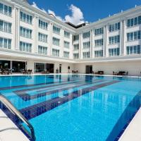 Mercia Hotels & Resorts </h2 <div class=sr-card__item sr-card__item--badges <div class= sr-card__badge sr-card__badge--class u-margin:0  data-ga-track=click data-ga-category=SR Card Click data-ga-action=Hotel rating data-ga-label=book_window:  day(s)  <i class= bk-icon-wrapper bk-icon-stars star_track  title=4 zvaigznes  <svg aria-hidden=true class=bk-icon -sprite-ratings_stars_4 focusable=false height=10 width=43<use xlink:href=#icon-sprite-ratings_stars_4</use</svg                     <span class=invisible_spoken4 zvaigznes</span </i </div   <div style=padding: 2px 0  <div class=bui-review-score c-score bui-review-score--smaller <div class=bui-review-score__badge aria-label=Viesu sniegtais vērtējums: 7,8 7,8 </div <div class=bui-review-score__content <div class=bui-review-score__title Labi </div </div </div   </div </div <div class=sr-card__item   data-ga-track=click data-ga-category=SR Card Click data-ga-action=Hotel location data-ga-label=book_window:  day(s)  <svg alt=Naktsmītnes atrašanās vieta class=bk-icon -iconset-geo_pin sr_svg__card_icon height=12 width=12<use xlink:href=#icon-iconset-geo_pin</use</svg <div class= sr-card__item__content   Kumburgaz • <span 1,3 km </span  no centra </div </div </div </div </a </li <div data-et-view=cJaQWPWNEQEDSVWe:1</div <li id=hotel_458050 data-is-in-favourites=0 data-hotel-id='458050' class=sr-card sr-card--arrow bui-card bui-u-bleed@small js-sr-card m_sr_info_icons card-halved card-halved--active   <a href=/hotel/tr/grand-gold-otel.lv.html target=_blank class=sr-card__row bui-card__content data-et-click=customGoal: aria-label=  Grand Gold Hotel,  Viesu sniegtais vērtējums: 6.6,      <div class=sr-card__image js-sr_simple_card_hotel_image has-debolded-deal js-lazy-image sr-card__image--lazy data-src=https://q-ec.bstatic.com/xdata/images/hotel/square200/210454742.jpg?k=001291a6501e90dd7376ac118cdc221bcbc8f66cc2a4792e131b70f7576dc1ad&o=&s=1,https://q-ec.bstatic.com/xdata/images/hotel/max1024x768/210454742.jpg?k=e00bca9444ff4eb65f150307124a49ecee3be1735f135d9569388336f0fedd0d&o=&s=1  <div class=sr-card__image-inner css-loading-hidden </div <noscript <div class=sr-card__image--nojs style=background-image: url('https://q-ec.bstatic.com/xdata/images/hotel/square200/210454742.jpg?k=001291a6501e90dd7376ac118cdc221bcbc8f66cc2a4792e131b70f7576dc1ad&o=&s=1')</div </noscript </div <div class=sr-card__details data-et-click=     <div class=sr-card_details__inner <h2 class=sr-card__name u-margin:0 u-padding:0 data-ga-track=click data-ga-category=SR Card Click data-ga-action=Hotel name data-ga-label=book_window:  day(s)  Grand Gold Hotel </h2 <div class=sr-card__item sr-card__item--badges <div class= sr-card__badge sr-card__badge--class u-margin:0  data-ga-track=click data-ga-category=SR Card Click data-ga-action=Hotel rating data-ga-label=book_window:  day(s)  <i class= bk-icon-wrapper bk-icon-stars star_track  title=3 zvaigznes  <svg aria-hidden=true class=bk-icon -sprite-ratings_stars_3 focusable=false height=10 width=32<use xlink:href=#icon-sprite-ratings_stars_3</use</svg                     <span class=invisible_spoken3 zvaigznes</span </i </div   <div style=padding: 2px 0  <div class=bui-review-score c-score bui-review-score--smaller <div class=bui-review-score__badge aria-label=Viesu sniegtais vērtējums: 6,6 6,6 </div <div class=bui-review-score__content <div class=bui-review-score__title Jauki </div </div </div   </div </div <div class=sr-card__item   data-ga-track=click data-ga-category=SR Card Click data-ga-action=Hotel location data-ga-label=book_window:  day(s)  <svg alt=Naktsmītnes atrašanās vieta class=bk-icon -iconset-geo_pin sr_svg__card_icon height=12 width=12<use xlink:href=#icon-iconset-geo_pin</use</svg <div class= sr-card__item__content   Kumburgaz • <span 1,1 km </span  no centra </div </div </div </div </a </li <div data-et-view=cJaQWPWNEQEDSVWe:1</div <li id=hotel_1587749 data-is-in-favourites=0 data-hotel-id='1587749' class=sr-card sr-card--arrow bui-card bui-u-bleed@small js-sr-card m_sr_info_icons card-halved card-halved--active   <a href=/hotel/tr/mavi-kumsal-otel.lv.html target=_blank class=sr-card__row bui-card__content data-et-click=customGoal: aria-label=  Mavi Kumsal Otel,  Viesu sniegtais vērtējums: 6.2,      <div class=sr-card__image js-sr_simple_card_hotel_image has-debolded-deal js-lazy-image sr-card__image--lazy data-src=https://r-ec.bstatic.com/xdata/images/hotel/square200/62971117.jpg?k=af2aec0390666ad5df6de4b776f05b3daa94b1f7c34faf4d516ad72ea8adee45&o=&s=1,https://q-ec.bstatic.com/xdata/images/hotel/max1024x768/62971117.jpg?k=a788d8e0002ef075a57516fad0fd9e1edfcc1b944f934cf31904484aa04940ee&o=&s=1  <div class=sr-card__image-inner css-loading-hidden </div <noscript <div class=sr-card__image--nojs style=background-image: url('https://r-ec.bstatic.com/xdata/images/hotel/square200/62971117.jpg?k=af2aec0390666ad5df6de4b776f05b3daa94b1f7c34faf4d516ad72ea8adee45&o=&s=1')</div </noscript </div <div class=sr-card__details data-et-click=     <div class=sr-card_details__inner <h2 class=sr-card__name u-margin:0 u-padding:0 data-ga-track=click data-ga-category=SR Card Click data-ga-action=Hotel name data-ga-label=book_window:  day(s)  Mavi Kumsal Otel </h2 <div class=sr-card__item sr-card__item--badges <div style=padding: 2px 0  <div class=bui-review-score c-score bui-review-score--smaller <div class=bui-review-score__badge aria-label=Viesu sniegtais vērtējums: 6,2 6,2 </div <div class=bui-review-score__content <div class=bui-review-score__title Jauki </div </div </div   </div </div <div class=sr-card__item   data-ga-track=click data-ga-category=SR Card Click data-ga-action=Hotel location data-ga-label=book_window:  day(s)  <svg alt=Naktsmītnes atrašanās vieta class=bk-icon -iconset-geo_pin sr_svg__card_icon height=12 width=12<use xlink:href=#icon-iconset-geo_pin</use</svg <div class= sr-card__item__content   Kumburgaz • <span 1,4 km </span  no centra </div </div </div </div </a </li <div data-et-view=cJaQWPWNEQEDSVWe:1</div <li id=hotel_1730804 data-is-in-favourites=0 data-hotel-id='1730804' class=sr-card sr-card--arrow bui-card bui-u-bleed@small js-sr-card m_sr_info_icons card-halved card-halved--active   <a href=/hotel/tr/emir-butik-otel.lv.html target=_blank class=sr-card__row bui-card__content data-et-click=customGoal: aria-label=  Emir Butik Otel,      <div class=sr-card__image js-sr_simple_card_hotel_image has-debolded-deal js-lazy-image sr-card__image--lazy data-src=https://q-ec.bstatic.com/xdata/images/hotel/square200/68334284.jpg?k=38e8b0e16e410c00e00491716da897e266a5fc8f97799aeb7c67fedd0122b46b&o=&s=1,https://q-ec.bstatic.com/xdata/images/hotel/max1024x768/68334284.jpg?k=4a6ed5b0732e880e3e8e473a75564bb34b2dc90d79716174bd1e2aac8c3053ef&o=&s=1  <div class=sr-card__image-inner css-loading-hidden </div <noscript <div class=sr-card__image--nojs style=background-image: url('https://q-ec.bstatic.com/xdata/images/hotel/square200/68334284.jpg?k=38e8b0e16e410c00e00491716da897e266a5fc8f97799aeb7c67fedd0122b46b&o=&s=1')</div </noscript </div <div class=sr-card__details data-et-click=     <div class=sr-card_details__inner <h2 class=sr-card__name u-margin:0 u-padding:0 data-ga-track=click data-ga-category=SR Card Click data-ga-action=Hotel name data-ga-label=book_window:  day(s)  Emir Butik Otel </h2 <div class=sr-card__item sr-card__item--badges <div style=padding: 2px 0    </div </div <div class=sr-card__item   data-ga-track=click data-ga-category=SR Card Click data-ga-action=Hotel location data-ga-label=book_window:  day(s)  <svg alt=Naktsmītnes atrašanās vieta class=bk-icon -iconset-geo_pin sr_svg__card_icon height=12 width=12<use xlink:href=#icon-iconset-geo_pin</use</svg <div class= sr-card__item__content   Kumburgaz • <span 600 m </span  no centra </div </div </div </div </a </li <div data-et-view=cJaQWPWNEQEDSVWe:1</div <li id=hotel_4070117 data-is-in-favourites=0 data-hotel-id='4070117' class=sr-card sr-card--arrow bui-card bui-u-bleed@small js-sr-card m_sr_info_icons card-halved card-halved--active   <a href=/hotel/tr/new-penguen.lv.html target=_blank class=sr-card__row bui-card__content data-et-click=customGoal: aria-label=  New Penguen Hotel,      <div class=sr-card__image js-sr_simple_card_hotel_image has-debolded-deal js-lazy-image sr-card__image--lazy data-src=https://q-ec.bstatic.com/xdata/images/hotel/square200/179090258.jpg?k=7cf041f7ec9d8b0b4e6ad03eeb72adf1afe4687ddfbfa17f5e85bede4398b385&o=&s=1,https://q-ec.bstatic.com/xdata/images/hotel/max1024x768/179090258.jpg?k=bfe386ca698893212d34224c4c1eb630bdcb98c8d67bb03e2e69e46ead57c2ee&o=&s=1  <div class=sr-card__image-inner css-loading-hidden </div <noscript <div class=sr-card__image--nojs style=background-image: url('https://q-ec.bstatic.com/xdata/images/hotel/square200/179090258.jpg?k=7cf041f7ec9d8b0b4e6ad03eeb72adf1afe4687ddfbfa17f5e85bede4398b385&o=&s=1')</div </noscript </div <div class=sr-card__details data-et-click=     <div class=sr-card_details__inner <h2 class=sr-card__name u-margin:0 u-padding:0 data-ga-track=click data-ga-category=SR Card Click data-ga-action=Hotel name data-ga-label=book_window:  day(s)  New Penguen Hotel </h2 <div class=sr-card__item sr-card__item--badges <div style=padding: 2px 0    </div </div <div class=sr-card__item   data-ga-track=click data-ga-category=SR Card Click data-ga-action=Hotel location data-ga-label=book_window:  day(s)  <svg alt=Naktsmītnes atrašanās vieta class=bk-icon -iconset-geo_pin sr_svg__card_icon height=12 width=12<use xlink:href=#icon-iconset-geo_pin</use</svg <div class= sr-card__item__content   Kumburgaz • <span 600 m </span  no centra </div </div </div </div </a </li <div data-et-view=cJaQWPWNEQEDSVWe:1</div <li class=bui-spacer--medium <div data-et-view=OLBEUBBCcMAZdJAINRe:1</div <div class=bui-alert bui-alert--info bui-u-bleed@small role=status data-e2e=auto_extension_banner <span class=icon--hint bui-alert__icon role=presentation <svg class=bk-icon -iconset-info_sign height=24 role=presentation width=24<use xlink:href=#icon-iconset-info_sign</use</svg </span <div class=bui-alert__description <p class=bui-alert__text <spanIeteikums</span - aplūkojiet šīs tuvumā esošās naktsmītnes </p </div </div </li <li id=hotel_687239 data-is-in-favourites=0 data-hotel-id='687239' class=sr-card sr-card--arrow bui-card bui-u-bleed@small js-sr-card m_sr_info_icons card-halved card-halved--active   <a href=/hotel/tr/otel-famadegly.lv.html target=_blank class=sr-card__row bui-card__content data-et-click=customGoal: aria-label=  Family Resort Spa &amp; Thalasso Thermal,  Viesu sniegtais vērtējums: 7.1,      <div class=sr-card__image js-sr_simple_card_hotel_image has-debolded-deal js-lazy-image sr-card__image--lazy data-src=https://r-ec.bstatic.com/xdata/images/hotel/square200/73367446.jpg?k=1d20a3137299f2e001eb5aae247470c8b5e1fa39aa9b2d66c66cd79efc8b2429&o=&s=1,https://r-ec.bstatic.com/xdata/images/hotel/max1024x768/73367446.jpg?k=34231e5f485b5ae6a11259efd295b55718762650f57bb105f2d240fc39c25070&o=&s=1  <div class=sr-card__image-inner css-loading-hidden </div <noscript <div class=sr-card__image--nojs style=background-image: url('https://r-ec.bstatic.com/xdata/images/hotel/square200/73367446.jpg?k=1d20a3137299f2e001eb5aae247470c8b5e1fa39aa9b2d66c66cd79efc8b2429&o=&s=1')</div </noscript </div <div class=sr-card__details data-et-click=     <div class=sr-card_details__inner <h2 class=sr-card__name u-margin:0 u-padding:0 data-ga-track=click data-ga-category=SR Card Click data-ga-action=Hotel name data-ga-label=book_window:  day(s)  Family Resort Spa & Thalasso Thermal </h2 <div class=sr-card__item sr-card__item--badges <div class= sr-card__badge sr-card__badge--class u-margin:0  data-ga-track=click data-ga-category=SR Card Click data-ga-action=Hotel rating data-ga-label=book_window:  day(s)  <i class= bk-icon-wrapper bk-icon-stars star_track  title=4 zvaigznes  <svg aria-hidden=true class=bk-icon -sprite-ratings_stars_4 focusable=false height=10 width=43<use xlink:href=#icon-sprite-ratings_stars_4</use</svg                     <span class=invisible_spoken4 zvaigznes</span </i </div   <div style=padding: 2px 0  <div class=bui-review-score c-score bui-review-score--smaller <div class=bui-review-score__badge aria-label=Viesu sniegtais vērtējums: 7,1 7,1 </div <div class=bui-review-score__content <div class=bui-review-score__title Labi </div </div </div   </div </div <div class=sr-card__item   data-ga-track=click data-ga-category=SR Card Click data-ga-action=Hotel location data-ga-label=book_window:  day(s)  <svg alt=Naktsmītnes atrašanās vieta class=bk-icon -iconset-geo_pin sr_svg__card_icon height=12 width=12<use xlink:href=#icon-iconset-geo_pin</use</svg <div class= sr-card__item__content   <strong class='sr-card__item--strong'Selimpasa</strong • <span 9 km </span  no vietas: Kumburgaz </div </div </div </div </a </li <div data-et-view=cJaQWPWNEQEDSVWe:1</div <li id=hotel_1778122 data-is-in-favourites=0 data-hotel-id='1778122' class=sr-card sr-card--arrow bui-card bui-u-bleed@small js-sr-card m_sr_info_icons card-halved card-halved--active   <a href=/hotel/tr/selimpasa.lv.html target=_blank class=sr-card__row bui-card__content data-et-click=customGoal: aria-label=  Hotel Selimpasa,  Viesu sniegtais vērtējums: 7.7,      <div class=sr-card__image js-sr_simple_card_hotel_image has-debolded-deal js-lazy-image sr-card__image--lazy data-src=https://r-ec.bstatic.com/xdata/images/hotel/square200/72145136.jpg?k=ccffff7a597c6c2b6b34dd1239401665bed6ad39c2f57b017a0247d70f327175&o=&s=1,https://q-ec.bstatic.com/xdata/images/hotel/max1024x768/72145136.jpg?k=d2a2fd3c350dde04ecd0c6d55137a9178b0d09010ef4c70d7d7fc2d03fcd7d07&o=&s=1  <div class=sr-card__image-inner css-loading-hidden </div <noscript <div class=sr-card__image--nojs style=background-image: url('https://r-ec.bstatic.com/xdata/images/hotel/square200/72145136.jpg?k=ccffff7a597c6c2b6b34dd1239401665bed6ad39c2f57b017a0247d70f327175&o=&s=1')</div </noscript </div <div class=sr-card__details data-et-click=     <div class=sr-card_details__inner <h2 class=sr-card__name u-margin:0 u-padding:0 data-ga-track=click data-ga-category=SR Card Click data-ga-action=Hotel name data-ga-label=book_window:  day(s)  Hotel Selimpasa </h2 <div class=sr-card__item sr-card__item--badges <div style=padding: 2px 0  <div class=bui-review-score c-score bui-review-score--smaller <div class=bui-review-score__badge aria-label=Viesu sniegtais vērtējums: 7,7 7,7 </div <div class=bui-review-score__content <div class=bui-review-score__title Labi </div </div </div   </div </div <div class=sr-card__item   data-ga-track=click data-ga-category=SR Card Click data-ga-action=Hotel location data-ga-label=book_window:  day(s)  <svg alt=Naktsmītnes atrašanās vieta class=bk-icon -iconset-geo_pin sr_svg__card_icon height=12 width=12<use xlink:href=#icon-iconset-geo_pin</use</svg <div class= sr-card__item__content   <strong class='sr-card__item--strong'Selimpasa</strong • <span 8 km </span  no vietas: Kumburgaz </div </div </div </div </a </li <div data-et-view=cJaQWPWNEQEDSVWe:1</div <li id=hotel_186735 data-is-in-favourites=0 data-hotel-id='186735' class=sr-card sr-card--arrow bui-card bui-u-bleed@small js-sr-card m_sr_info_icons card-halved card-halved--active   <a href=/hotel/tr/eser-premium-spa.lv.html target=_blank class=sr-card__row bui-card__content data-et-click=customGoal: aria-label=  Eser Premium Hotel &amp; Spa,  Viesu sniegtais vērtējums: 8,      <div class=sr-card__image js-sr_simple_card_hotel_image has-debolded-deal js-lazy-image sr-card__image--lazy data-src=https://q-ec.bstatic.com/xdata/images/hotel/square200/130902469.jpg?k=b143f13d590cfe0defbbd687ec98e4a9ae789c9970a058bd551cb8695e253e2c&o=&s=1,https://q-ec.bstatic.com/xdata/images/hotel/max1024x768/130902469.jpg?k=55bf98dc47f5b9bc470bb09d67d911a5ff7ecf7b8aa29bf8dfc873b950763744&o=&s=1  <div class=sr-card__image-inner css-loading-hidden </div <noscript <div class=sr-card__image--nojs style=background-image: url('https://q-ec.bstatic.com/xdata/images/hotel/square200/130902469.jpg?k=b143f13d590cfe0defbbd687ec98e4a9ae789c9970a058bd551cb8695e253e2c&o=&s=1')</div </noscript </div <div class=sr-card__details data-et-click=     <div class=sr-card_details__inner <h2 class=sr-card__name u-margin:0 u-padding:0 data-ga-track=click data-ga-category=SR Card Click data-ga-action=Hotel name data-ga-label=book_window:  day(s)  Eser Premium Hotel & Spa </h2 <div class=sr-card__item sr-card__item--badges <div class= sr-card__badge sr-card__badge--class u-margin:0  data-ga-track=click data-ga-category=SR Card Click data-ga-action=Hotel rating data-ga-label=book_window:  day(s)  <i class= bk-icon-wrapper bk-icon-stars star_track  title=5 zvaigznes  <svg aria-hidden=true class=bk-icon -sprite-ratings_stars_5 focusable=false height=10 width=54<use xlink:href=#icon-sprite-ratings_stars_5</use</svg                     <span class=invisible_spoken5 zvaigznes</span </i </div   <div style=padding: 2px 0  <div class=bui-review-score c-score bui-review-score--smaller <div class=bui-review-score__badge aria-label=Viesu sniegtais vērtējums: 8,0 8,0 </div <div class=bui-review-score__content <div class=bui-review-score__title Ļoti labi </div </div </div   </div </div <div class=sr-card__item   data-ga-track=click data-ga-category=SR Card Click data-ga-action=Hotel location data-ga-label=book_window:  day(s)  <svg alt=Naktsmītnes atrašanās vieta class=bk-icon -iconset-geo_pin sr_svg__card_icon height=12 width=12<use xlink:href=#icon-iconset-geo_pin</use</svg <div class= sr-card__item__content   <strong class='sr-card__item--strong'Büyükçekmece</strong • <span 11 km </span  no vietas: Kumburgaz </div </div </div </div </a </li <div data-et-view=cJaQWPWNEQEDSVWe:1</div <li id=hotel_192196 data-is-in-favourites=0 data-hotel-id='192196' class=sr-card sr-card--arrow bui-card bui-u-bleed@small js-sr-card m_sr_info_icons card-halved card-halved--active   <a href=/hotel/tr/silivri-park.lv.html target=_blank class=sr-card__row bui-card__content data-et-click=customGoal: aria-label=  Silivri Park Hotel,  Viesu sniegtais vērtējums: 8.1,      <div class=sr-card__image js-sr_simple_card_hotel_image has-debolded-deal js-lazy-image sr-card__image--lazy data-src=https://r-ec.bstatic.com/xdata/images/hotel/square200/25439304.jpg?k=91dc328dec7ed7e618123a05e9dab0fbe474e645358e50cce169d93db7318c9b&o=&s=1,https://q-ec.bstatic.com/xdata/images/hotel/max1024x768/25439304.jpg?k=68cf5383fa6325237ea670eb80d5bbc629bd761ec65d9c761e0594ffc5671491&o=&s=1  <div class=sr-card__image-inner css-loading-hidden </div <noscript <div class=sr-card__image--nojs style=background-image: url('https://r-ec.bstatic.com/xdata/images/hotel/square200/25439304.jpg?k=91dc328dec7ed7e618123a05e9dab0fbe474e645358e50cce169d93db7318c9b&o=&s=1')</div </noscript </div <div class=sr-card__details data-et-click=     <div class=sr-card_details__inner <h2 class=sr-card__name u-margin:0 u-padding:0 data-ga-track=click data-ga-category=SR Card Click data-ga-action=Hotel name data-ga-label=book_window:  day(s)  Silivri Park Hotel </h2 <div class=sr-card__item sr-card__item--badges <div class= sr-card__badge sr-card__badge--class u-margin:0  data-ga-track=click data-ga-category=SR Card Click data-ga-action=Hotel rating data-ga-label=book_window:  day(s)  <i class= bk-icon-wrapper bk-icon-stars star_track  title=3 zvaigznes  <svg aria-hidden=true class=bk-icon -sprite-ratings_stars_3 focusable=false height=10 width=32<use xlink:href=#icon-sprite-ratings_stars_3</use</svg                     <span class=invisible_spoken3 zvaigznes</span </i </div   <div style=padding: 2px 0  <div class=bui-review-score c-score bui-review-score--smaller <div class=bui-review-score__badge aria-label=Viesu sniegtais vērtējums: 8,1 8,1 </div <div class=bui-review-score__content <div class=bui-review-score__title Ļoti labi </div </div </div   </div </div <div class=sr-card__item   data-ga-track=click data-ga-category=SR Card Click data-ga-action=Hotel location data-ga-label=book_window:  day(s)  <svg alt=Naktsmītnes atrašanās vieta class=bk-icon -iconset-geo_pin sr_svg__card_icon height=12 width=12<use xlink:href=#icon-iconset-geo_pin</use</svg <div class= sr-card__item__content   <strong class='sr-card__item--strong'Silivri</strong • <span 18 km </span  no vietas: Kumburgaz </div </div </div </div </a </li <div data-et-view=cJaQWPWNEQEDSVWe:1</div <li id=hotel_2925355 data-is-in-favourites=0 data-hotel-id='2925355' class=sr-card sr-card--arrow bui-card bui-u-bleed@small js-sr-card m_sr_info_icons card-halved card-halved--active   <a href=/hotel/tr/garden-residence-suite.lv.html target=_blank class=sr-card__row bui-card__content data-et-click=customGoal: aria-label=  Garden Suite &amp; Hotel,  Viesu sniegtais vērtējums: 9.2,      <div class=sr-card__image js-sr_simple_card_hotel_image has-debolded-deal js-lazy-image sr-card__image--lazy data-src=https://q-ec.bstatic.com/xdata/images/hotel/square200/210612500.jpg?k=b746168ceae8b0c4f43c4b2c2d44ab31a1c92ce95b95352d14f67b7159b6e86f&o=&s=1,https://q-ec.bstatic.com/xdata/images/hotel/max1024x768/210612500.jpg?k=6c7577d9eac4ed3f4b8f1f6df6a18cb02ccb43653be1711ab4204963c24bccf6&o=&s=1  <div class=sr-card__image-inner css-loading-hidden </div <noscript <div class=sr-card__image--nojs style=background-image: url('https://q-ec.bstatic.com/xdata/images/hotel/square200/210612500.jpg?k=b746168ceae8b0c4f43c4b2c2d44ab31a1c92ce95b95352d14f67b7159b6e86f&o=&s=1')</div </noscript </div <div class=sr-card__details data-et-click=     <div class=sr-card_details__inner <div data-et-view= NAFQICFHUeUEBEbOMFcZSGNVBUKcTKe:1 NAFQICFHUeUEBEbOMFcZSGNVBUKcTKe:2  NAFQICFHUeUEBEbOMFcZSGNVBUKcTKe:5   </div <h2 class=sr-card__name u-margin:0 u-padding:0 data-ga-track=click data-ga-category=SR Card Click data-ga-action=Hotel name data-ga-label=book_window:  day(s)  Garden Suite & Hotel </h2 <div class=sr-card__item sr-card__item--badges <div style=padding: 2px 0  <div class=bui-review-score c-score bui-review-score--smaller <div class=bui-review-score__badge aria-label=Viesu sniegtais vērtējums: 9,2 9,2 </div <div class=bui-review-score__content <div class=bui-review-score__title Lieliski </div </div </div   </div </div <div class=sr-card__item   data-ga-track=click data-ga-category=SR Card Click data-ga-action=Hotel location data-ga-label=book_window:  day(s)  <svg alt=Naktsmītnes atrašanās vieta class=bk-icon -iconset-geo_pin sr_svg__card_icon height=12 width=12<use xlink:href=#icon-iconset-geo_pin</use</svg <div class= sr-card__item__content   <strong class='sr-card__item--strong'Esenyurt</strong • <span 16 km </span  no vietas: Kumburgaz </div </div </div </div </a </li <div data-et-view=cJaQWPWNEQEDSVWe:1</div <li id=hotel_419241 data-is-in-favourites=0 data-hotel-id='419241' data-lazy-load-nd class=sr-card sr-card--arrow bui-card bui-u-bleed@small js-sr-card m_sr_info_icons card-halved card-halved--active   <a href=/hotel/tr/avm-apart-konaklama.lv.html target=_blank class=sr-card__row bui-card__content data-et-click=customGoal: aria-label=  Expoist Hotel,  Viesu sniegtais vērtējums: 8,      <div class=sr-card__image js-sr_simple_card_hotel_image has-debolded-deal js-lazy-image sr-card__image--lazy data-src=https://q-ec.bstatic.com/xdata/images/hotel/square200/79843877.jpg?k=85346e49bb575cbddc90c35072711f628d6ac7a818f286f4f4104aaedbe682b7&o=&s=1,https://r-ec.bstatic.com/xdata/images/hotel/max1024x768/79843877.jpg?k=cbaecc4e47ba6fb48f6f06ca169285e14519d18321d06e42c68142e3137cd202&o=&s=1  <div class=sr-card__image-inner css-loading-hidden </div <noscript <div class=sr-card__image--nojs style=background-image: url('https://q-ec.bstatic.com/xdata/images/hotel/square200/79843877.jpg?k=85346e49bb575cbddc90c35072711f628d6ac7a818f286f4f4104aaedbe682b7&o=&s=1')</div </noscript </div <div class=sr-card__details data-et-click=     <div class=sr-card_details__inner <h2 class=sr-card__name u-margin:0 u-padding:0 data-ga-track=click data-ga-category=SR Card Click data-ga-action=Hotel name data-ga-label=book_window:  day(s)  Expoist Hotel </h2 <div class=sr-card__item sr-card__item--badges <div style=padding: 2px 0  <div class=bui-review-score c-score bui-review-score--smaller <div class=bui-review-score__badge aria-label=Viesu sniegtais vērtējums: 8,0 8,0 </div <div class=bui-review-score__content <div class=bui-review-score__title Ļoti labi </div </div </div   </div </div <div class=sr-card__item   data-ga-track=click data-ga-category=SR Card Click data-ga-action=Hotel location data-ga-label=book_window:  day(s)  <svg alt=Naktsmītnes atrašanās vieta class=bk-icon -iconset-geo_pin sr_svg__card_icon height=12 width=12<use xlink:href=#icon-iconset-geo_pin</use</svg <div class= sr-card__item__content   <strong class='sr-card__item--strong'Bejlikduzu</strong • <span 14 km </span  no vietas: Kumburgaz </div </div </div </div </a </li <div data-et-view=cJaQWPWNEQEDSVWe:1</div <li id=hotel_593829 data-is-in-favourites=0 data-hotel-id='593829' class=sr-card sr-card--arrow bui-card bui-u-bleed@small js-sr-card m_sr_info_icons card-halved card-halved--active   <a href=/hotel/tr/turkuaz-port.lv.html target=_blank class=sr-card__row bui-card__content data-et-click=customGoal: aria-label=  Turkuaz Port Hotel,  Viesu sniegtais vērtējums: 7.3,      <div class=sr-card__image js-sr_simple_card_hotel_image has-debolded-deal js-lazy-image sr-card__image--lazy data-src=https://q-ec.bstatic.com/xdata/images/hotel/square200/79840313.jpg?k=9829ac662db3c3ec722297cc47a7b81a1ebb5179ce9b606764da3a96d84699b4&o=&s=1,https://q-ec.bstatic.com/xdata/images/hotel/max1024x768/79840313.jpg?k=7c81df9fd4254b9533fc39bf5e8595ffbf2d06bf9255f86d2eb91cf9b7ee50fa&o=&s=1  <div class=sr-card__image-inner css-loading-hidden </div <noscript <div class=sr-card__image--nojs style=background-image: url('https://q-ec.bstatic.com/xdata/images/hotel/square200/79840313.jpg?k=9829ac662db3c3ec722297cc47a7b81a1ebb5179ce9b606764da3a96d84699b4&o=&s=1')</div </noscript </div <div class=sr-card__details data-et-click=     <div class=sr-card_details__inner <h2 class=sr-card__name u-margin:0 u-padding:0 data-ga-track=click data-ga-category=SR Card Click data-ga-action=Hotel name data-ga-label=book_window:  day(s)  Turkuaz Port Hotel </h2 <div class=sr-card__item sr-card__item--badges <div style=padding: 2px 0  <div class=bui-review-score c-score bui-review-score--smaller <div class=bui-review-score__badge aria-label=Viesu sniegtais vērtējums: 7,3 7,3 </div <div class=bui-review-score__content <div class=bui-review-score__title Labi </div </div </div   </div </div <div class=sr-card__item   data-ga-track=click data-ga-category=SR Card Click data-ga-action=Hotel location data-ga-label=book_window:  day(s)  <svg alt=Naktsmītnes atrašanās vieta class=bk-icon -iconset-geo_pin sr_svg__card_icon height=12 width=12<use xlink:href=#icon-iconset-geo_pin</use</svg <div class= sr-card__item__content   <strong class='sr-card__item--strong'Büyükçekmece</strong • <span 11 km </span  no vietas: Kumburgaz </div </div </div </div </a </li <div data-et-view=cJaQWPWNEQEDSVWe:1</div <li id=hotel_591096 data-is-in-favourites=0 data-hotel-id='591096' class=sr-card sr-card--arrow bui-card bui-u-bleed@small js-sr-card m_sr_info_icons card-halved card-halved--active   <a href=/hotel/tr/euro-park.lv.html target=_blank class=sr-card__row bui-card__content data-et-click=customGoal: aria-label=  Euro Park Hotel,  Viesu sniegtais vērtējums: 8.1,      <div class=sr-card__image js-sr_simple_card_hotel_image has-debolded-deal js-lazy-image sr-card__image--lazy data-src=https://q-ec.bstatic.com/xdata/images/hotel/square200/25092345.jpg?k=bd78e3c96e6e3efac10cc0b47109f3277111948df8d6a03002f44140d98aaeea&o=&s=1,https://r-ec.bstatic.com/xdata/images/hotel/max1024x768/25092345.jpg?k=cb7f42c0cba6faeb0a2b034028903d5548db5358d4a4b379261cf2514b8bec4f&o=&s=1  <div class=sr-card__image-inner css-loading-hidden </div <noscript <div class=sr-card__image--nojs style=background-image: url('https://q-ec.bstatic.com/xdata/images/hotel/square200/25092345.jpg?k=bd78e3c96e6e3efac10cc0b47109f3277111948df8d6a03002f44140d98aaeea&o=&s=1')</div </noscript </div <div class=sr-card__details data-et-click=     <div class=sr-card_details__inner <h2 class=sr-card__name u-margin:0 u-padding:0 data-ga-track=click data-ga-category=SR Card Click data-ga-action=Hotel name data-ga-label=book_window:  day(s)  Euro Park Hotel </h2 <div class=sr-card__item sr-card__item--badges <div class= sr-card__badge sr-card__badge--class u-margin:0  data-ga-track=click data-ga-category=SR Card Click data-ga-action=Hotel rating data-ga-label=book_window:  day(s)  <i class= bk-icon-wrapper bk-icon-stars star_track  title=5 zvaigznes  <svg aria-hidden=true class=bk-icon -sprite-ratings_stars_5 focusable=false height=10 width=54<use xlink:href=#icon-sprite-ratings_stars_5</use</svg                     <span class=invisible_spoken5 zvaigznes</span </i </div   <div style=padding: 2px 0  <div class=bui-review-score c-score bui-review-score--smaller <div class=bui-review-score__badge aria-label=Viesu sniegtais vērtējums: 8,1 8,1 </div <div class=bui-review-score__content <div class=bui-review-score__title Ļoti labi </div </div </div   </div </div <div class=sr-card__item   data-ga-track=click data-ga-category=SR Card Click data-ga-action=Hotel location data-ga-label=book_window:  day(s)  <svg alt=Naktsmītnes atrašanās vieta class=bk-icon -iconset-geo_pin sr_svg__card_icon height=12 width=12<use xlink:href=#icon-iconset-geo_pin</use</svg <div class= sr-card__item__content   <strong class='sr-card__item--strong'Bejlikduzu</strong • <span 15 km </span  no vietas: Kumburgaz </div </div </div </div </a </li <div data-et-view=cJaQWPWNEQEDSVWe:1</div <li id=hotel_880087 data-is-in-favourites=0 data-hotel-id='880087' class=sr-card sr-card--arrow bui-card bui-u-bleed@small js-sr-card m_sr_info_icons card-halved card-halved--active   <a href=/hotel/tr/readegs-adegnn.lv.html target=_blank class=sr-card__row bui-card__content data-et-click=customGoal: aria-label=  Reis Inn Hotel,  Viesu sniegtais vērtējums: 7.9,      <div class=sr-card__image js-sr_simple_card_hotel_image has-debolded-deal js-lazy-image sr-card__image--lazy data-src=https://q-ec.bstatic.com/xdata/images/hotel/square200/57476167.jpg?k=a596b84a8e10927e4c4e3c44ea7f448c2e3cad055a7c94e4ad2145fa46d05e14&o=&s=1,https://q-ec.bstatic.com/xdata/images/hotel/max1024x768/57476167.jpg?k=59c4eab1abe81985f14d2255c15b51fd9dbb6d698503ee7a8befd7e85b97c308&o=&s=1  <div class=sr-card__image-inner css-loading-hidden </div <noscript <div class=sr-card__image--nojs style=background-image: url('https://q-ec.bstatic.com/xdata/images/hotel/square200/57476167.jpg?k=a596b84a8e10927e4c4e3c44ea7f448c2e3cad055a7c94e4ad2145fa46d05e14&o=&s=1')</div </noscript </div <div class=sr-card__details data-et-click=     <div class=sr-card_details__inner <h2 class=sr-card__name u-margin:0 u-padding:0 data-ga-track=click data-ga-category=SR Card Click data-ga-action=Hotel name data-ga-label=book_window:  day(s)  Reis Inn Hotel </h2 <div class=sr-card__item sr-card__item--badges <div class= sr-card__badge sr-card__badge--class u-margin:0  data-ga-track=click data-ga-category=SR Card Click data-ga-action=Hotel rating data-ga-label=book_window:  day(s)  <i class= bk-icon-wrapper bk-icon-stars star_track  title=4 zvaigznes  <svg aria-hidden=true class=bk-icon -sprite-ratings_stars_4 focusable=false height=10 width=43<use xlink:href=#icon-sprite-ratings_stars_4</use</svg                     <span class=invisible_spoken4 zvaigznes</span </i </div   <div style=padding: 2px 0  <div class=bui-review-score c-score bui-review-score--smaller <div class=bui-review-score__badge aria-label=Viesu sniegtais vērtējums: 7,9 7,9 </div <div class=bui-review-score__content <div class=bui-review-score__title Labi </div </div </div   </div </div <div class=sr-card__item   data-ga-track=click data-ga-category=SR Card Click data-ga-action=Hotel location data-ga-label=book_window:  day(s)  <svg alt=Naktsmītnes atrašanās vieta class=bk-icon -iconset-geo_pin sr_svg__card_icon height=12 width=12<use xlink:href=#icon-iconset-geo_pin</use</svg <div class= sr-card__item__content   <strong class='sr-card__item--strong'Bejlikduzu</strong • <span 15 km </span  no vietas: Kumburgaz </div </div </div </div </a </li <div data-et-view=cJaQWPWNEQEDSVWe:1</div <li id=hotel_403034 data-is-in-favourites=0 data-hotel-id='403034' class=sr-card sr-card--arrow bui-card bui-u-bleed@small js-sr-card m_sr_info_icons card-halved card-halved--active   <a href=/hotel/tr/vadegsta-sadegladegvradeg.lv.html target=_blank class=sr-card__row bui-card__content data-et-click=customGoal: aria-label=  Vista Hotel Silivri,  Viesu sniegtais vērtējums: 7.4,      <div class=sr-card__image js-sr_simple_card_hotel_image has-debolded-deal js-lazy-image sr-card__image--lazy data-src=https://r-ec.bstatic.com/xdata/images/hotel/square200/202975754.jpg?k=3774e1af2b94068ebb3e7cdfc78c0a341db0e3efe882138c921c284ca6b28b38&o=&s=1,https://r-ec.bstatic.com/xdata/images/hotel/max1024x768/202975754.jpg?k=8ba3aaa42a84cdc0661a8c0ee8773453bc5d2c2d874962df0c512659ecc72272&o=&s=1  <div class=sr-card__image-inner css-loading-hidden </div <noscript <div class=sr-card__image--nojs style=background-image: url('https://r-ec.bstatic.com/xdata/images/hotel/square200/202975754.jpg?k=3774e1af2b94068ebb3e7cdfc78c0a341db0e3efe882138c921c284ca6b28b38&o=&s=1')</div </noscript </div <div class=sr-card__details data-et-click=     <div class=sr-card_details__inner <h2 class=sr-card__name u-margin:0 u-padding:0 data-ga-track=click data-ga-category=SR Card Click data-ga-action=Hotel name data-ga-label=book_window:  day(s)  Vista Hotel Silivri </h2 <div class=sr-card__item sr-card__item--badges <div class= sr-card__badge sr-card__badge--class u-margin:0  data-ga-track=click data-ga-category=SR Card Click data-ga-action=Hotel rating data-ga-label=book_window:  day(s)  <i class= bk-icon-wrapper bk-icon-stars star_track  title=4 zvaigznes  <svg aria-hidden=true class=bk-icon -sprite-ratings_stars_4 focusable=false height=10 width=43<use xlink:href=#icon-sprite-ratings_stars_4</use</svg                     <span class=invisible_spoken4 zvaigznes</span </i </div   <div style=padding: 2px 0  <div class=bui-review-score c-score bui-review-score--smaller <div class=bui-review-score__badge aria-label=Viesu sniegtais vērtējums: 7,4 7,4 </div <div class=bui-review-score__content <div class=bui-review-score__title Labi </div </div </div   </div </div <div class=sr-card__item   data-ga-track=click data-ga-category=SR Card Click data-ga-action=Hotel location data-ga-label=book_window:  day(s)  <svg alt=Naktsmītnes atrašanās vieta class=bk-icon -iconset-geo_pin sr_svg__card_icon height=12 width=12<use xlink:href=#icon-iconset-geo_pin</use</svg <div class= sr-card__item__content   <strong class='sr-card__item--strong'Silivri</strong • <span 11 km </span  no vietas: Kumburgaz </div </div </div </div </a </li <div data-et-view=YdXfCDWOOWNTUMKHcWIbVTeMAFQZHT:2</div <div data-et-view=cJaQWPWNEQEDSVWe:1</div <li id=hotel_3049226 data-is-in-favourites=0 data-hotel-id='3049226' class=sr-card sr-card--arrow bui-card bui-u-bleed@small js-sr-card m_sr_info_icons card-halved card-halved--active   <a href=/hotel/tr/selimpasa-suits.lv.html target=_blank class=sr-card__row bui-card__content data-et-click=customGoal: aria-label=  Selimpasa Suits,  Viesu sniegtais vērtējums: 5.9,      <div class=sr-card__image js-sr_simple_card_hotel_image has-debolded-deal js-lazy-image sr-card__image--lazy data-src=https://q-ec.bstatic.com/xdata/images/hotel/square200/193471121.jpg?k=ff2f32145a9f8ab7477202001e69a49c5da1846cbbdc80b570c4d0810eab1492&o=&s=1,https://q-ec.bstatic.com/xdata/images/hotel/max1024x768/193471121.jpg?k=6a1babfc50c4496186385224bf73110ca695155c9808d8feae6b1281a1019d87&o=&s=1  <div class=sr-card__image-inner css-loading-hidden </div <noscript <div class=sr-card__image--nojs style=background-image: url('https://q-ec.bstatic.com/xdata/images/hotel/square200/193471121.jpg?k=ff2f32145a9f8ab7477202001e69a49c5da1846cbbdc80b570c4d0810eab1492&o=&s=1')</div </noscript </div <div class=sr-card__details data-et-click=     <div class=sr-card_details__inner <div data-et-view= NAFQICFHUeUEBEbOMFcZSGNVBUKcTKe:1 NAFQICFHUeUEBEbOMFcZSGNVBUKcTKe:2  NAFQICFHUeUEBEbOMFcZSGNVBUKcTKe:5   </div <h2 class=sr-card__name u-margin:0 u-padding:0 data-ga-track=click data-ga-category=SR Card Click data-ga-action=Hotel name data-ga-label=book_window:  day(s)  Selimpasa Suits </h2 <div class=sr-card__item sr-card__item--badges <div style=padding: 2px 0  <div class=bui-review-score c-score bui-review-score--smaller <div class=bui-review-score__badge aria-label=Viesu sniegtais vērtējums: 5,9 5,9 </div <div class=bui-review-score__content <div class=bui-review-score__title Pietiekami labi </div </div </div   </div </div <div class=sr-card__item   data-ga-track=click data-ga-category=SR Card Click data-ga-action=Hotel location data-ga-label=book_window:  day(s)  <svg alt=Naktsmītnes atrašanās vieta class=bk-icon -iconset-geo_pin sr_svg__card_icon height=12 width=12<use xlink:href=#icon-iconset-geo_pin</use</svg <div class= sr-card__item__content   <strong class='sr-card__item--strong'Silivri</strong • <span 6 km </span  no vietas: Kumburgaz </div </div </div </div </a </li <div data-et-view=cJaQWPWNEQEDSVWe:1</div <li id=hotel_1496515 data-is-in-favourites=0 data-hotel-id='1496515' class=sr-card sr-card--arrow bui-card bui-u-bleed@small js-sr-card m_sr_info_icons card-halved card-halved--active   <a href=/hotel/tr/hilton-garden-inn-istanbul-beylikduzu.lv.html target=_blank class=sr-card__row bui-card__content data-et-click=customGoal: aria-label=  Hilton Garden Inn Istanbul Beylikduzu,  Viesu sniegtais vērtējums: 8.4,      <div class=sr-card__image js-sr_simple_card_hotel_image has-debolded-deal js-lazy-image sr-card__image--lazy data-src=https://r-ec.bstatic.com/xdata/images/hotel/square200/53838404.jpg?k=01be887c2d235514c0cd642d93d56dfa68e86baf2dab4613582532e6617a22c9&o=&s=1,https://r-ec.bstatic.com/xdata/images/hotel/max1024x768/53838404.jpg?k=f313f7b63cfca9434b129e04486ed946eddf1acbf73a85cd937767ad0c21bcee&o=&s=1  <div class=sr-card__image-inner css-loading-hidden </div <noscript <div class=sr-card__image--nojs style=background-image: url('https://r-ec.bstatic.com/xdata/images/hotel/square200/53838404.jpg?k=01be887c2d235514c0cd642d93d56dfa68e86baf2dab4613582532e6617a22c9&o=&s=1')</div </noscript </div <div class=sr-card__details data-et-click=     <div class=sr-card_details__inner <h2 class=sr-card__name u-margin:0 u-padding:0 data-ga-track=click data-ga-category=SR Card Click data-ga-action=Hotel name data-ga-label=book_window:  day(s)  Hilton Garden Inn Istanbul Beylikduzu </h2 <div class=sr-card__item sr-card__item--badges <div class= sr-card__badge sr-card__badge--class u-margin:0  data-ga-track=click data-ga-category=SR Card Click data-ga-action=Hotel rating data-ga-label=book_window:  day(s)  <i class= bk-icon-wrapper bk-icon-stars star_track  title=4 zvaigznes  <svg aria-hidden=true class=bk-icon -sprite-ratings_stars_4 focusable=false height=10 width=43<use xlink:href=#icon-sprite-ratings_stars_4</use</svg                     <span class=invisible_spoken4 zvaigznes</span </i </div   <div style=padding: 2px 0  <div class=bui-review-score c-score bui-review-score--smaller <div class=bui-review-score__badge aria-label=Viesu sniegtais vērtējums: 8,4 8,4 </div <div class=bui-review-score__content <div class=bui-review-score__title Ļoti labi </div </div </div   </div </div <div class=sr-card__item   data-ga-track=click data-ga-category=SR Card Click data-ga-action=Hotel location data-ga-label=book_window:  day(s)  <svg alt=Naktsmītnes atrašanās vieta class=bk-icon -iconset-geo_pin sr_svg__card_icon height=12 width=12<use xlink:href=#icon-iconset-geo_pin</use</svg <div class= sr-card__item__content   <strong class='sr-card__item--strong'Bejlikduzu</strong • <span 15 km </span  no vietas: Kumburgaz </div </div </div </div </a </li <div data-et-view=cJaQWPWNEQEDSVWe:1</div <li id=hotel_1456847 data-is-in-favourites=0 data-hotel-id='1456847' class=sr-card sr-card--arrow bui-card bui-u-bleed@small js-sr-card m_sr_info_icons card-halved card-halved--active   <a href=/hotel/tr/realist.lv.html target=_blank class=sr-card__row bui-card__content data-et-click=customGoal: aria-label=  Realist Hotel,  Viesu sniegtais vērtējums: 8.3,      <div class=sr-card__image js-sr_simple_card_hotel_image has-debolded-deal js-lazy-image sr-card__image--lazy data-src=https://q-ec.bstatic.com/xdata/images/hotel/square200/175520585.jpg?k=d8eb0a0aad044b7d975e195a52f179d25ae383d0f6c47cff8257d96d926d5c99&o=&s=1,https://r-ec.bstatic.com/xdata/images/hotel/max1024x768/175520585.jpg?k=753a0caff8ee494a33195bad1099e87c2ca682a559a526a4542803e93bd3b260&o=&s=1  <div class=sr-card__image-inner css-loading-hidden </div <noscript <div class=sr-card__image--nojs style=background-image: url('https://q-ec.bstatic.com/xdata/images/hotel/square200/175520585.jpg?k=d8eb0a0aad044b7d975e195a52f179d25ae383d0f6c47cff8257d96d926d5c99&o=&s=1')</div </noscript </div <div class=sr-card__details data-et-click=     <div class=sr-card_details__inner <h2 class=sr-card__name u-margin:0 u-padding:0 data-ga-track=click data-ga-category=SR Card Click data-ga-action=Hotel name data-ga-label=book_window:  day(s)  Realist Hotel </h2 <div class=sr-card__item sr-card__item--badges <div style=padding: 2px 0  <div class=bui-review-score c-score bui-review-score--smaller <div class=bui-review-score__badge aria-label=Viesu sniegtais vērtējums: 8,3 8,3 </div <div class=bui-review-score__content <div class=bui-review-score__title Ļoti labi </div </div </div   </div </div <div class=sr-card__item   data-ga-track=click data-ga-category=SR Card Click data-ga-action=Hotel location data-ga-label=book_window:  day(s)  <svg alt=Naktsmītnes atrašanās vieta class=bk-icon -iconset-geo_pin sr_svg__card_icon height=12 width=12<use xlink:href=#icon-iconset-geo_pin</use</svg <div class= sr-card__item__content   <strong class='sr-card__item--strong'Bejlikduzu</strong • <span 19 km </span  no vietas: Kumburgaz </div </div </div </div </a </li <div data-et-view=cJaQWPWNEQEDSVWe:1</div <li id=hotel_797145 data-is-in-favourites=0 data-hotel-id='797145' class=sr-card sr-card--arrow bui-card bui-u-bleed@small js-sr-card m_sr_info_icons card-halved card-halved--active   <a href=/hotel/tr/dab.lv.html target=_blank class=sr-card__row bui-card__content data-et-click=customGoal: aria-label=  Dab Hotel,  Viesu sniegtais vērtējums: 7.7,      <div class=sr-card__image js-sr_simple_card_hotel_image has-debolded-deal js-lazy-image sr-card__image--lazy data-src=https://q-ec.bstatic.com/xdata/images/hotel/square200/102324422.jpg?k=f0769e2f1f43aa47b5e12e243039eb8ea300aba879e8453cdfecd7a453622ce0&o=&s=1,https://q-ec.bstatic.com/xdata/images/hotel/max1024x768/102324422.jpg?k=40b45a6900bdf8fd13e152a0d0a621ec9951c0bea3177301cac005837903730a&o=&s=1  <div class=sr-card__image-inner css-loading-hidden </div <noscript <div class=sr-card__image--nojs style=background-image: url('https://q-ec.bstatic.com/xdata/images/hotel/square200/102324422.jpg?k=f0769e2f1f43aa47b5e12e243039eb8ea300aba879e8453cdfecd7a453622ce0&o=&s=1')</div </noscript </div <div class=sr-card__details data-et-click=     <div class=sr-card_details__inner <h2 class=sr-card__name u-margin:0 u-padding:0 data-ga-track=click data-ga-category=SR Card Click data-ga-action=Hotel name data-ga-label=book_window:  day(s)  Dab Hotel </h2 <div class=sr-card__item sr-card__item--badges <div style=padding: 2px 0  <div class=bui-review-score c-score bui-review-score--smaller <div class=bui-review-score__badge aria-label=Viesu sniegtais vērtējums: 7,7 7,7 </div <div class=bui-review-score__content <div class=bui-review-score__title Labi </div </div </div   </div </div <div class=sr-card__item   data-ga-track=click data-ga-category=SR Card Click data-ga-action=Hotel location data-ga-label=book_window:  day(s)  <svg alt=Naktsmītnes atrašanās vieta class=bk-icon -iconset-geo_pin sr_svg__card_icon height=12 width=12<use xlink:href=#icon-iconset-geo_pin</use</svg <div class= sr-card__item__content   <strong class='sr-card__item--strong'Esenyurt</strong • <span 18 km </span  no vietas: Kumburgaz </div </div </div </div </a </li <div data-et-view=cJaQWPWNEQEDSVWe:1</div <li id=hotel_362279 data-is-in-favourites=0 data-hotel-id='362279' class=sr-card sr-card--arrow bui-card bui-u-bleed@small js-sr-card m_sr_info_icons card-halved card-halved--active   <a href=/hotel/tr/double-tree-by-hilton-istanbul-avcilar.lv.html target=_blank class=sr-card__row bui-card__content data-et-click=customGoal: aria-label=  DoubleTree by Hilton Istanbul-Avcilar,  Viesu sniegtais vērtējums: 8.4,      <div class=sr-card__image js-sr_simple_card_hotel_image has-debolded-deal js-lazy-image sr-card__image--lazy data-src=https://r-ec.bstatic.com/xdata/images/hotel/square200/61282638.jpg?k=343cdc0f18b2c9f9121cc38c3979909bb12ec7bc4d2e0c8317ff341863a84bd0&o=&s=1,https://r-ec.bstatic.com/xdata/images/hotel/max1024x768/61282638.jpg?k=113c30d0d592cf54600a319023dd1de43468c4477c7eef045d359bea33c8a946&o=&s=1  <div class=sr-card__image-inner css-loading-hidden </div <noscript <div class=sr-card__image--nojs style=background-image: url('https://r-ec.bstatic.com/xdata/images/hotel/square200/61282638.jpg?k=343cdc0f18b2c9f9121cc38c3979909bb12ec7bc4d2e0c8317ff341863a84bd0&o=&s=1')</div </noscript </div <div class=sr-card__details data-et-click=     <div class=sr-card_details__inner <h2 class=sr-card__name u-margin:0 u-padding:0 data-ga-track=click data-ga-category=SR Card Click data-ga-action=Hotel name data-ga-label=book_window:  day(s)  DoubleTree by Hilton Istanbul-Avcilar </h2 <div class=sr-card__item sr-card__item--badges <div class= sr-card__badge sr-card__badge--class u-margin:0  data-ga-track=click data-ga-category=SR Card Click data-ga-action=Hotel rating data-ga-label=book_window:  day(s)  <i class= bk-icon-wrapper bk-icon-stars star_track  title=5 zvaigznes  <svg aria-hidden=true class=bk-icon -sprite-ratings_stars_5 focusable=false height=10 width=54<use xlink:href=#icon-sprite-ratings_stars_5</use</svg                     <span class=invisible_spoken5 zvaigznes</span </i </div   <div style=padding: 2px 0  <div class=bui-review-score c-score bui-review-score--smaller <div class=bui-review-score__badge aria-label=Viesu sniegtais vērtējums: 8,4 8,4 </div <div class=bui-review-score__content <div class=bui-review-score__title Ļoti labi </div </div </div   </div </div <div class=sr-card__item   data-ga-track=click data-ga-category=SR Card Click data-ga-action=Hotel location data-ga-label=book_window:  day(s)  <svg alt=Naktsmītnes atrašanās vieta class=bk-icon -iconset-geo_pin sr_svg__card_icon height=12 width=12<use xlink:href=#icon-iconset-geo_pin</use</svg <div class= sr-card__item__content   <strong class='sr-card__item--strong'Avcılar</strong • <span 21 km </span  no vietas: Kumburgaz </div </div </div </div </a </li </ol </div </div <div data-block=pagination <div id=sr_pagination class=sr-pager  sr-pager--end   <span class=sr-pager__label 1 no 11 </span <a class=sr-pager__link js-pagination-next-link href=https://www.booking.com/searchresults.lv.html Nākamā <svg alt=Nākamā class=bk-icon -iconset-navarrow_right sr-pager__icon height=128 width=128<use xlink:href=#icon-iconset-navarrow_right</use</svg </a </div </div <script if( window.performance && performance.measure && 'b-fold') { performance.measure('b-fold'); } </script  <script (function () { if (typeof EventTarget !== 'undefined') { if (typeof EventTarget.prototype.dispatchEvent === 'undefined' && typeof EventTarget.prototype.fireEvent === 'function') { EventTarget.prototype.dispatchEvent = EventTarget.prototype.fireEvent; } } if (typeof window.CustomEvent !== 'function') { // Mobile IE has CustomEvent implemented as Object, this fixes it. var CustomEvent = function(event, params) { // don't delete var evt; params = params || {bubbles: false, cancelable: false, detail: undefined}; try { evt = document.createEvent('CustomEvent'); evt.initCustomEvent(event, params.bubbles, params.cancelable, params.detail); } catch (error) { // fallback for browsers that don't support createEvent('CustomEvent') evt = document.createEvent(Event); for (var param in params) { evt[param] = params[param]; } evt.initEvent(event, params.bubbles, params.cancelable); } return evt; }; CustomEvent.prototype = window.Event.prototype; window.CustomEvent = CustomEvent; } if (!Element.prototype.matches) { Element.prototype.matches = Element.prototype.matchesSelector || Element.prototype.msMatchesSelector || Element.prototype.oMatchesSelector || Element.prototype.webkitMatchesSelector; } if (!Element.prototype.closest) { Element.prototype.closest = function(s) { var el = this; if (!document.documentElement.contains(el)) return null; do { if (el.matches(s)) return el; el = el.parentElement || el.parentNode; } while (el !== null && el.nodeType === 1); return null; }; } }()); (function(){ var searchboxEl = document.querySelector('.js-searchbox_redesign'); if (!searchboxEl) return; var groupChildren = searchboxEl.querySelector('[name=group_children]'); var childAgesEl = searchboxEl.querySelector('.js-child-ages'); var childAgesLabelEl = searchboxEl.querySelector('.js-child-ages-label'); var ageOptionHTML; var childrenNo; function showChildrenAges() { childAgesEl.style.display = 'block'; childAgesLabelEl.style.display = 'block'; } function hideChildrenAges() { childAgesEl.style.display = 'none'; childAgesLabelEl.style.display = 'none'; } function onGroupChildenChange(e) { var newValue = parseInt(e.target.value); if (newValue  childrenNo) { for (var i = newValue; i  childrenNo; i--) { childAgesEl.insertAdjacentHTML('beforeend', ageOptionHTML); } } else { var els = childAgesEl.querySelectorAll('.js-age-option-container'); for (var i = els.length - 1; i = 0; i--) { if (i = newValue) { var el = els[i]; if (el.parentNode !== null) { el.parentNode.removeChild(el); } } } } if (newValue == 0 && childrenNo  0) { hideChildrenAges(); } if (newValue  0 && childrenNo == 0) { showChildrenAges(); } childrenNo = newValue; } if (groupChildren) { groupChildren.disabled = false; childrenNo = parseInt(groupChildren.value); if (childrenNo  0) { showChildrenAges(); } ageOptionHTML = document.querySelector('#sb-age-option-container').innerHTML; groupChildren.addEventListener('change', onGroupChildenChange); document.addEventListener('cp:sb-group-children-ready', function() { groupChildren.removeEventListener('change', onGroupChildenChange); }); } }()); </script <div class=css-loading-hidden m_lp_below_fold_container <div id=sr_nearby_destinations data-component=sr_lazy_load_nearby_destinations </div </div </div </div <div class= tabbed-nav--content tabbed-nav--content__search tabbed-nav--content__search-with-tabs  data-tab-id=search id=tabbed_search  <div class= sb__tabs js-sb__tabs <div class= sb__tabs__item js-sb__tabs__item active data-id=sb_hotels  <form id=form_search_location class=js-searchbox_redesign searchbox_redesign searchbox_redesign--iphone searchForm searchbox_fullwidth placeholder_clear b-no-tap-highlight name=frm action=/searchresults.lv.html method=get data-component=searchbox/destination/near-me  <input type=hidden value=searchresults name=src <input type=hidden name=rows value=20 / <input type=hidden name=error_url value=https://www.booking.com/index.lv.html; / <input type=hidden name=label value=gen000nr-10CAQoggJCDGNpdHlfLTc2MzIyNUgaWARoigGIAQKYATO4AQXIAQ3YAQPoAQH4AQGIAgGoAgG4Are36uoFwAIB / <input type=hidden name=lang value=lv / <input type=hidden name=sb value=1 <div class=destination-bar <div id=searchbox_tab <div id=input_destination_wrap <input type=hidden name=city value=-763225 / <input type=hidden name=ssne value=Kumburgaz / <input type=hidden name=ssne_untouched value=Kumburgaz / <div class=searchbox_input_with_suggestion ui-autocomplete-root <div class=dest-input--with-icons <svg aria-hidden=true class=bk-icon -fonticon-search bk-icon--search sr-svg--header_icon_search focusable=false height=14 width=15<use xlink:href=#icon-fonticon-search</use</svg <input type=search id=input_destination name=ss spellcheck=false autocapitalize=off autocorrect=off autocomplete=off class= input_destination js-input_dest has_placeholder input_clear_button_input aria-label=Ievadiet šeit savu galamērķi value=Kumburgaz  <button class=input_clear_button type=button  <svg class=bk-icon -fonticon-aclose bk-icon--aclose sr-svg--header_icon_aclose height=12 width=14<use xlink:href=#icon-fonticon-aclose</use</svg </button </div </div </div <div id=location_loading style=display: none  class= <img id=loading_icon src=https://r-ec.bstatic.com/mobile/images/hotelMarkerImgLoader/211f81a092a43bf96fc2a7b1dff37e5bc08fbbbf.gif alt=Loading your location / Ielādē pašreizējo atrašanās vietu </div <div id=location_found style=display: none  <div id=location_found_text Ap pašreizējo atrašanās vietu </div </div </div </div <fieldset class= searchbox_cals dualcal searchbox_cals_nojs  data-checkin= data-checkout=  <script type=text/html class=js-cal-inputs <input type=hidden name=checkin_monthday value=19 / <input type=hidden name=checkin_year_month value=2019-8 / <input type=hidden name=checkout_monthday value=20 / <input type=hidden name=checkout_year_month value=2019-8 / </script <div class=searchbox_cals_container <div id=ci_date class= bar b-no-tap-highlight js-searchbox__input dualcal__checkin  data-action=toggle data-clicked-before-ready=0 data-cal=checkin  <div class=bar--container <label class=dual_cal_label Reģistrēšanās datums </label <div id=ci_date_field <span id=ci_date_text class=m_cal_date_string js-loading-invisible data-checkin-text Pr, 2019. gada 19. aug. </span </div <svg class=bk-icon -fonticon-checkin searchbox-icon fill=currentColor height=24 width=24<use xlink:href=#icon-fonticon-checkin</use</svg </div <div id=searchBoxLoaderDateCheckIn class=searchbox-before-ready-loading <div class=pure-css-spinner</div </div <select name=checkin_monthday class=js-cal-nojs-input  <option value=Diena</option <option value=1 1</option <option value=2 2</option <option value=3 3</option <option value=4 4</option <option value=5 5</option <option value=6 6</option <option value=7 7</option <option value=8 8</option <option value=9 9</option <option value=10 10</option <option value=11 11</option <option value=12 12</option <option value=13 13</option <option value=14 14</option <option value=15 15</option <option value=16 16</option <option value=17 17</option <option value=18 18</option <option value=19 selected=selected 19</option <option value=20 20</option <option value=21 21</option <option value=22 22</option <option value=23 23</option <option value=24 24</option <option value=25 25</option <option value=26 26</option <option value=27 27</option <option value=28 28</option <option value=29 29</option <option value=30 30</option <option value=31 31</option </select <select name=checkin_year_month class=js-cal-nojs-input  <option value=Mēnesis</option <option value=2019-8 selected=selected  Augusts 2019 </option <option value=2019-9  Septembris 2019 </option <option value=2019-10  Oktobris 2019 </option <option value=2019-11  Novembris 2019 </option <option value=2019-12  Decembris 2019 </option <option value=2020-1  Janvāris 2020 </option <option value=2020-2  Februāris 2020 </option <option value=2020-3  Marts 2020 </option <option value=2020-4  Aprīlis 2020 </option <option value=2020-5  Maijs 2020 </option <option value=2020-6  Jūnijs 2020 </option <option value=2020-7  Jūlijs 2020 </option <option value=2020-8  Augusts 2020 </option </select <input type=hidden disabled id=ci_date_input name=checkin value=2019-08-19 / </div <div id=co_date class= bar b-no-tap-highlight js-searchbox__input dualcal__checkout  data-action=toggle data-clicked-before-ready=0 data-cal=checkout  <div class=bar--container <label class=dual_cal_label Izrakstīšanās datums </label <div id=co_date_field <span id=co_date_text class=m_cal_date_string js-loading-invisible data-checkout-text Ot, 2019. gada 20. aug. </span </div <svg class=bk-icon -fonticon-checkin searchbox-icon fill=currentColor height=24 width=24<use xlink:href=#icon-fonticon-checkin</use</svg <div id=searchBoxLoaderDateCheckOut class=searchbox-before-ready-loading <div class=pure-css-spinner</div </div </div <select name=checkout_monthday class=js-cal-nojs-input  <option value=Diena</option <option value=1 1</option <option value=2 2</option <option value=3 3</option <option value=4 4</option <option value=5 5</option <option value=6 6</option <option value=7 7</option <option value=8 8</option <option value=9 9</option <option value=10 10</option <option value=11 11</option <option value=12 12</option <option value=13 13</option <option value=14 14</option <option value=15 15</option <option value=16 16</option <option value=17 17</option <option value=18 18</option <option value=19 19</option <option value=20 selected=selected 20</option <option value=21 21</option <option value=22 22</option <option value=23 23</option <option value=24 24</option <option value=25 25</option <option value=26 26</option <option value=27 27</option <option value=28 28</option <option value=29 29</option <option value=30 30</option <option value=31 31</option </select <select name=checkout_year_month class=js-cal-nojs-input  <option value=Mēnesis</option <option value=2019-8 selected=selected  Augusts 2019 </option <option value=2019-9  Septembris 2019 </option <option value=2019-10  Oktobris 2019 </option <option value=2019-11  Novembris 2019 </option <option value=2019-12  Decembris 2019 </option <option value=2020-1  Janvāris 2020 </option <option value=2020-2  Februāris 2020 </option <option value=2020-3  Marts 2020 </option <option value=2020-4  Aprīlis 2020 </option <option value=2020-5  Maijs 2020 </option <option value=2020-6  Jūnijs 2020 </option <option value=2020-7  Jūlijs 2020 </option <option value=2020-8  Augusts 2020 </option </select <input type=hidden id=co_date_input disabled name=checkout value=2019-08-20 / </div </div <div class=dualcal-pikaday pikaday-checkin checkInCal css-loading-hidden pikaday-highlighted-weekends  </div <div class=dualcal-pikaday pikaday-checkout checkOutCal css-loading-hidden pikaday-highlighted-weekends  </div </fieldset <input class=js-first-room-param-setup type=hidden name=room1 value=A,A disabled / <input class=pageshow-anchor type=hidden autocomplete=on value= <fieldset class=group_search group_options js-searchbox__input b-no-tap-highlight  <label class=group_options_label <span class=group_options_label--textPieaugušie</span <select class=group_adults name=group_adults  <optgroup <option value=11</option <option value=2 selected=selected2</option <option value=33</option <option value=44</option <option value=55</option <option value=66</option <option value=77</option <option value=88</option <option value=99</option <option value=1010</option <option value=1111</option <option value=1212</option <option value=1313</option <option value=1414</option <option value=1515</option <option value=1616</option <option value=1717</option <option value=1818</option <option value=1919</option <option value=2020</option <option value=2121</option <option value=2222</option <option value=2323</option <option value=2424</option <option value=2525</option <option value=2626</option <option value=2727</option <option value=2828</option <option value=2929</option <option value=3030</option </optgroup </select </label<label class=group_options_label <span class=group_options_label--text Bērni </span <select name=group_children class=group_children  <optgroup <option value=0 selected=selected0</option <option value=11</option <option value=22</option <option value=33</option <option value=44</option <option value=55</option <option value=66</option <option value=77</option <option value=88</option <option value=99</option <option value=1010</option </optgroup </select </label <label class=group_options_label js-sr-rooms-selector group_options_label_last<span class=group_options_label--textNumuri</span<select class=group_rooms name=no_rooms<optgroup<option  value=11</option<option  value=22</option<option  value=33</option<option  value=44</option<option  value=55</option<option  value=66</option<option  value=77</option<option  value=88</option<option  value=99</option<option  value=1010</option<option  value=1111</option<option  value=1212</option<option  value=1313</option<option  value=1414</option<option  value=1515</option<option  value=1616</option<option  value=1717</option<option  value=1818</option<option  value=1919</option<option  value=2020</option<option  value=2121</option<option  value=2222</option<option  value=2323</option<option  value=2424</option<option  value=2525</option<option  value=2626</option<option  value=2727</option<option  value=2828</option<option  value=2929</option<option  value=3030</option</optgroup</select</label <label class=child_ages_label js-child-ages-label Bērnu vecums izrakstīšanās laikā </label <div class=clx child_ages js-child-ages </div </fieldset <input type=hidden name=search_form_id value=7ad65a9bc5ce0285 <fieldset class=searchbox_purpose searchbox_purpose__radios data-component=searchbox/travel-purpose/hint <div class=searchbox--radio-group <div class=searchbox--radio-group--label js-travel-purpose-label <span class=searchbox--radio-group--text Vai jūs dodaties darba darīšanās? </span <svg class=bk-icon -fonticon-questionmarkcircle searchbox--radio-group--hintmark css-loading-hidden height=16 width=16<use xlink:href=#icon-fonticon-questionmarkcircle</use</svg </div <div class=searchbox--radio-group--hintbox css-loading-hidden <span class=searchbox--radio-group--hintbox-text Ja jūs ceļojat darba vajadzībām, mēs sakārtosim komandējumos visiecienītākās iespējas filtru izvēlnes augšpusē, lai jūs tās varētu ātri atrast. </span </div <label class=searchbox--radio-group--item searchbox--radio-group--item__business <input name=sb_travel_purpose type=radio class=searchbox--radio-group--input value=business  <span class=searchbox--radio-group--text Jā </span </label <label class=searchbox--radio-group--item searchbox--radio-group--item__leisure <input name=sb_travel_purpose type=radio class=searchbox--radio-group--input value=leisure  <span class=searchbox--radio-group--text Nē </span </label </div </fieldset <button id=submit_search class=primary_cta js_submit_search js-searchbox__input b-no-tap-highlight m_bigger_search_button type=submit title=Meklēt viesnīcas Meklēt </button </form <template id=sb-age-option-container <div class=age_option-container  js-age-option-container <select name=age class=age <optgroup <option value=0 selected  0 </option <option value=1  1 </option <option value=2  2 </option <option value=3  3 </option <option value=4  4 </option <option value=5  5 </option <option value=6  6 </option <option value=7  7 </option <option value=8  8 </option <option value=9  9 </option <option value=10  10 </option <option value=11  11 </option <option value=12  12 </option <option value=13  13 </option <option value=14  14 </option <option value=15  15 </option <option value=16  16 </option <option value=17  17 </option </optgroup </select </div </template </div </div <a class=iam-banner-link href=https://account.booking.com/auth/oauth2?lang=lv&state=UvMB1ZO7rTiGYzmt51N5EzTkkdN_0sPA9jKnCDdfEl8ELyFIRdpCxvcEAwgqOL7Ivki8F95FUJdTxlKvmWfFVA6bonaWrr6OKadRF5GcpGIkiKG1vsHdRjzuAGe_OSjco4ljXHxdG2gTZp7TJbxF1h6Vd-E_yxCyMOKtCjqiKqqvO0fafzs07IaWqFgLlyS-PGT1vHyQ82apGQy2i6ctpLrpBK4FZLcmDXSJ31636mVafsKFHwNy8bTraAvoA7Cj6zJL4LETdzprx4nQVbElX9lg16EOD3opBQQrkVI2mbVouiVRgCVKBaqpMWcs2qN_Ulx9BMiV&aid=304142&response_type=code&dt=1566219191&client_id=vO1Kblk7xX9tUn2cpZLS&redirect_uri=https%3A%2F%2Fsecure.booking.com%2Flogin.html%3Fop%3Doauth_return aria-describedby=signin_banner_desc_01 <div class=bui-container <div class=bui-card bui-banner bui-u-bleed@small <svg class=bk-icon -iconset-user_account_outline bui-banner__icon height=24 role=presentation width=24<use xlink:href=#icon-iconset-user_account_outline</use</svg <div class=bui-banner__content <header class=bui-card__header <h1 class=bui-card__titleIenāciet, lai ietaupītu vairāk!</h1 <h2 class=bui-card__subtitle id=signin_banner_desc_01Ienāciet, lai atklātu labākās cenas</h2 </header </div </div </div </a <div class=tabbed-nav--content__search--usps </div </div <div class=tabbed-nav--content tabbed-nav--content__signin data-tab-id=signin data-async-content id=tabbed_signin <div class=tabbed-nav--loader</div <div class=async-signin-retry async-signin-retry__hidden <h3 class=async-signin-retry__headingRadās kļūme. <brLūdzu, mēģiniet vēlreiz.