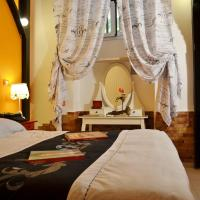 Hotel Capannelle Roma </h2 <div class=sr-card__item sr-card__item--badges <div class= sr-card__badge sr-card__badge--class u-margin:0  data-ga-track=click data-ga-category=SR Card Click data-ga-action=Hotel rating data-ga-label=book_window: 10 day(s)  <i class= bk-icon-wrapper bk-icon-stars star_track  title=4 stelle  <svg aria-hidden=true class=bk-icon -sprite-ratings_stars_4 focusable=false height=10 width=43<use xlink:href=#icon-sprite-ratings_stars_4</use</svg                     <span class=invisible_spoken4 stelle</span </i </div   <div class=m-badge m-badge__preferred m-badge__preferred--moved m-badge__preferred--small <svg aria-hidden=true class=bk-icon -iconset-thumbs_up_square  pp-icon-valign--inherit fill=#FEBB02 height=20 rel=300 title= Questa struttura è nel programma Preferiti perché offre un servizio eccellente e un ottimo rapporto qualità-prezzo. Per partecipare al programma, questa struttura potrebbe pagare a Booking.com una commissione un po' più alta.    width=20<use xlink:href=#icon-iconset-thumbs_up_square</use</svg <span class=invisible_spokenQuesta struttura è nel programma Preferiti perché offre un servizio eccellente e un ottimo rapporto qualità-prezzo. Per partecipare al programma, questa struttura potrebbe pagare a Booking.com una commissione un po' più alta. </span </div <div style=padding: 2px 0  <div class=bui-review-score c-score bui-review-score--smaller <div class=bui-review-score__badge aria-label=Punteggio di 7,7 7,7 </div <div class=bui-review-score__content <div class=bui-review-score__title Buono </div </div </div   </div </div <div class=sr-card__item   data-ga-track=click data-ga-category=SR Card Click data-ga-action=Hotel location data-ga-label=book_window: 10 day(s)  <svg alt=Posizione della struttura class=bk-icon -iconset-geo_pin sr_svg__card_icon height=12 width=12<use xlink:href=#icon-iconset-geo_pin</use</svg <div class= sr-card__item__content   Appio Latino, Roma • a   da Vaticano Prati	 </div </div <div class=sr-card__item    <svg alt= class=bk-icon -iconset-clock sr_svg__card_icon height=12 width=12<use xlink:href=#icon-iconset-clock</use</svg <div class= sr-card__item__content   Ultima prenotazione per le tue date 22 ore fa </div </div </div <div class= sr-card__price m_sr_card__price_with_unit_name sr-card-color-constructive-dark  data-et-view=  OMOQcUFDCXSWAbDZAWe:1    <div class=m_sr_card__price_unit_name m_sr_card__price_small Camera Standard Matrimoniale/Doppia con Letti Singoli </div <div data-et-view=OMeRQWNdbLGMGcZUYaTTDPdVO:1</div <div data-et-view=OMeRQWNdbLGMGcZUYaTTDPdVO:9</div    <div class=sr_price_wrap    data-et-view=       <span class= sr-card__price-rack-rate  data-component=tooltip data-tooltip-text= data-deal-rack=rackrate data-discount=34 data-ga-track=click data-ga-category=SR Card Click data-ga-action=Rack rate data-ga-label=book_window: 10 day(s)  TL 335 </span   <span class=sr-card__price-cheapest  data-ga-track=click data-ga-category=SR Card Click data-ga-action=Hotel price data-ga-label=book_window: 10 day(s)   TL 222 </span  </div       <div class=prd-taxes-and-fees-under-price  blockuid- charges-type-2 data-excl-charges-raw=79.05 data-cur-stage=2  + TL 79 di tasse e costi  </div     <div class=breakfast_included--constructive u-font-weight:bold </div </div </div </a </li <div data-et-view=cJaQWPWNEQEDSVWe:1</div <li id=hotel_4141569 data-is-in-favourites=0 data-hotel-id='4141569' class=sr-card sr-card--arrow bui-card bui-u-bleed@small js-sr-card m_sr_info_icons card-halved card-halved--active   <a href=/hotel/it/vichyenichy.it.html?label=gen173nr-1FCAQoggJCCmRpc3RyaWN0X1hIFFgEaOQBiAEBmAEUuAEYyAEF2AEB6AEB-AEDiAIBqAIEuALjuqToBcACAQ&sid=2065f6096823ac1c8a8a0815d70eced3&all_sr_blocks=414156902_134603147_0_0_0&checkin=2019-06-28&checkout=2019-06-29&dest_type=district&hapos=17&highlighted_blocks=414156902_134603147_0_0_0&hpos=17&nflt=pri%3D&sr_order=price&srepoch=1560878436&srpvid=2d4e79f18c4e012e&ucfs=1&bhgwe_cep=1&bhgwe_bhr=1&matching_block_id=414156902_134603147_2_0_0&srhp=1&ref_is_wl=1 target=_blank class=sr-card__row bui-card__content data-et-click=customGoal:NAREFcMEbFeceMaNCTYAKe:4 aria-label=  VichyeNichy,  TL 224    <div class=sr-card__image js-sr_simple_card_hotel_image has-debolded-deal js-lazy-image sr-card__image--lazy data-src=https://r-ec.bstatic.com/xdata/images/hotel/square200/181451977.jpg?k=33db20f649be286ca061e175dcdae46186ffb451ce394257dc3d4e4074d2d440&o=&s=1,https://r-ec.bstatic.com/xdata/images/hotel/max1024x768/181451977.jpg?k=9712203a6173a679ae84a5d1e1a5c03c46ccf4f65b7ad7dff291c67ec1f59553&o=&s=1  <div class=sr-card__image-inner css-loading-hidden </div <noscript <div class=sr-card__image--nojs style=background-image: url('https://r-ec.bstatic.com/xdata/images/hotel/square200/181451977.jpg?k=33db20f649be286ca061e175dcdae46186ffb451ce394257dc3d4e4074d2d440&o=&s=1')</div </noscript </div <div class=sr-card__details data-et-click=     <div class=sr-card_details__inner <div data-et-view= NAFQICFHUeUEBETbTLeeZAAZbeEHJNAFLPGWEYZLPYO:1 NAFQICFHUeUEBETbTLeeZAAZbeEHJNAFLPGWEYZLPYO:2 </div <h2 class=sr-card__name u-margin:0 u-padding:0 data-ga-track=click data-ga-category=SR Card Click data-ga-action=Hotel name data-ga-label=book_window: 10 day(s)  VichyeNichy </h2 <div class=sr-card__item sr-card__item--badges <div class= sr-card__badge sr-card__badge--class u-margin:0  data-ga-track=click data-ga-category=SR Card Click data-ga-action=Hotel rating data-ga-label=book_window: 10 day(s)  <span class=bh-quality-bars bh-quality-bars--small  data-et-click=customGoal:NAFQOeaLQeUYCSJabJNCRbQfXJOOIBBO:4  <svg class=bk-icon -iconset-square_rating fill=#FEBB02 height=16 width=16<use xlink:href=#icon-iconset-square_rating</use</svg<svg class=bk-icon -iconset-square_rating fill=#FEBB02 height=16 width=16<use xlink:href=#icon-iconset-square_rating</use</svg<svg class=bk-icon -iconset-square_rating fill=#FEBB02 height=16 width=16<use xlink:href=#icon-iconset-square_rating</use</svg </span </div   <div class=m-badge m-badge__preferred m-badge__preferred--moved m-badge__preferred--small <svg aria-hidden=true class=bk-icon -iconset-thumbs_up_square  pp-icon-valign--inherit fill=#FEBB02 height=20 rel=300 title= Questa struttura è nel programma Preferiti perché offre un servizio eccellente e un ottimo rapporto qualità-prezzo. Per partecipare al programma, questa struttura potrebbe pagare a Booking.com una commissione un po' più alta.    width=20<use xlink:href=#icon-iconset-thumbs_up_square</use</svg <span class=invisible_spokenQuesta struttura è nel programma Preferiti perché offre un servizio eccellente e un ottimo rapporto qualità-prezzo. Per partecipare al programma, questa struttura potrebbe pagare a Booking.com una commissione un po' più alta. </span </div <div style=padding: 2px 0    </div </div <div class=sr-card__item   data-ga-track=click data-ga-category=SR Card Click data-ga-action=Hotel location data-ga-label=book_window: 10 day(s)  <svg alt=Posizione della struttura class=bk-icon -iconset-geo_pin sr_svg__card_icon height=12 width=12<use xlink:href=#icon-iconset-geo_pin</use</svg <div class= sr-card__item__content   , Morena • a   da Vaticano Prati	 </div </div </div <div class= sr-card__price m_sr_card__price_with_unit_name sr-card-color-constructive-dark  data-et-view=  OMOQcUFDCXSWAbDZAWe:1    <div class=m_sr_card__price_unit_name m_sr_card__price_small Appartamento Monolocale </div <div data-et-view=OMeRQWNdbLGMGcZUYaTTDPdVO:6</div <div data-et-view=OMeRQWNdbLGMGcZUYaTTDPdVO:9</div    <div class=sr_price_wrap   sr_simple_card_price--include-free-cancelation   data-et-view=      <span class=sr-card__price-cheapest  data-ga-track=click data-ga-category=SR Card Click data-ga-action=Hotel price data-ga-label=book_window: 10 day(s)   TL 224 </span  </div       <div class=prd-taxes-and-fees-under-price  blockuid- charges-type-2 data-excl-charges-raw=144.92 data-cur-stage=2  + TL 145 di tasse e costi  </div     <p class=urgency_price   <span class=sr_simple_card_price_from sr_simple_card_price_includes--text data-ga-track=click data-ga-category=SR Card Click data-ga-action=Hotel price persuasion data-ga-label=book_window: 10 day(s) data-et-view=   Ce ne rimane solo <span class=sr-card__item--strong1</span! </span </p <div class=breakfast_included--constructive u-font-weight:bold </div <p class=sr_simple_card_price_includes css-loading-hidden <span Cancellazione <span class=sr-card__item--strongGRATUITA</span </span </p </div </div </a </li <div data-et-view=cJaQWPWNEQEDSVWe:1</div <li id=hotel_849413 data-is-in-favourites=0 data-hotel-id='849413' class=sr-card sr-card--arrow bui-card bui-u-bleed@small js-sr-card m_sr_info_icons card-halved card-halved--active   <a href=/hotel/it/simpatia-massalongo.it.html?label=gen173nr-1FCAQoggJCCmRpc3RyaWN0X1hIFFgEaOQBiAEBmAEUuAEYyAEF2AEB6AEB-AEDiAIBqAIEuALjuqToBcACAQ&sid=2065f6096823ac1c8a8a0815d70eced3&all_sr_blocks=84941303_120402343_2_42_0&checkin=2019-06-28&checkout=2019-06-29&dest_type=district&hapos=18&highlighted_blocks=84941303_120402343_2_42_0&hpos=18&nflt=pri%3D&sr_order=price&srepoch=1560878436&srpvid=2d4e79f18c4e012e&ucfs=1&matching_block_id=84941303_120402343_2_0_0&srhp=1&ref_is_wl=1 target=_blank class=sr-card__row bui-card__content aria-label=  Casa Simpatia Massalongo,  Punteggio di 7,  TL 224    <div class=sr-card__image js-sr_simple_card_hotel_image has-debolded-deal js-lazy-image sr-card__image--lazy data-src=https://q-ec.bstatic.com/xdata/images/hotel/square200/42181181.jpg?k=d09edb94cd1c4775e423ca7e69f1817d09d2244206fc1a3520ef2316c140ae65&o=&s=1,https://r-ec.bstatic.com/xdata/images/hotel/max1024x768/42181181.jpg?k=6c10a945823b8b71cc899ac90f9ab7487da48f248e040432625b6feef4d18843&o=&s=1  <div class=sr-card__image-inner css-loading-hidden <div  class= sr_simple_card--deal  sr_text_shadow  data-ga-track=click data-ga-category=SR Card Click data-ga-action=Bottom ribbon data-ga-label=book_window: 10 day(s)    Occasione di oggi </div </div <noscript <div class=sr-card__image--nojs style=background-image: url('https://q-ec.bstatic.com/xdata/images/hotel/square200/42181181.jpg?k=d09edb94cd1c4775e423ca7e69f1817d09d2244206fc1a3520ef2316c140ae65&o=&s=1')</div </noscript </div <div class=sr-card__details data-et-click=     <div class=sr-card_details__inner <h2 class=sr-card__name u-margin:0 u-padding:0 data-ga-track=click data-ga-category=SR Card Click data-ga-action=Hotel name data-ga-label=book_window: 10 day(s)  Casa Simpatia Massalongo </h2 <div class=sr-card__item sr-card__item--badges <div style=padding: 2px 0  <div class=bui-review-score c-score bui-review-score--smaller <div class=bui-review-score__badge aria-label=Punteggio di 7,0 7,0 </div <div class=bui-review-score__content <div class=bui-review-score__title Buono </div </div </div   </div </div <div class=sr-card__item   data-ga-track=click data-ga-category=SR Card Click data-ga-action=Hotel location data-ga-label=book_window: 10 day(s)  <svg alt=Posizione della struttura class=bk-icon -iconset-geo_pin sr_svg__card_icon height=12 width=12<use xlink:href=#icon-iconset-geo_pin</use</svg <div class= sr-card__item__content   Tiburtino, Roma • a   da Vaticano Prati	 </div </div </div <div class= sr-card__price sr-card__price--urgency m_sr_card__price_with_unit_name sr-card-color-constructive-dark  data-et-view=  OMOQcUFDCXSWAbDZAWe:1    <div class=m_sr_card__price_unit_name m_sr_card__price_small Camera Tripla con Doccia </div <div data-et-view=OMeRQWNdbLGMGcZUYaTTDPdVO:1</div <div data-et-view=OMeRQWNdbLGMGcZUYaTTDPdVO:6</div <div data-et-view=OMeRQWNdbLGMGcZUYaTTDPdVO:9</div    <div class=sr_price_wrap    data-et-view=       <span class= sr-card__price-rack-rate  data-component=tooltip data-tooltip-text= data-deal-rack=rackrate data-discount=24 data-ga-track=click data-ga-category=SR Card Click data-ga-action=Rack rate data-ga-label=book_window: 10 day(s)  TL 296 </span   <span class=sr-card__price-cheapest  data-ga-track=click data-ga-category=SR Card Click data-ga-action=Hotel price data-ga-label=book_window: 10 day(s)   TL 224 </span  </div       <div class=prd-taxes-and-fees-under-price  blockuid- charges-type-2 data-excl-charges-raw=177.85 data-cur-stage=2  + TL 178 di tasse e costi  </div     <p class=urgency_price   <span class=sr_simple_card_price_from sr_simple_card_price_includes--text data-ga-track=click data-ga-category=SR Card Click data-ga-action=Hotel price persuasion data-ga-label=book_window: 10 day(s) data-et-view=   Ce ne rimane solo <span class=sr-card__item--strong1</span! </span </p <div class=breakfast_included--constructive u-font-weight:bold </div </div </div </a </li <div data-et-view=cJaQWPWNEQEDSVWe:1</div <li id=hotel_3324765 data-is-in-favourites=0 data-hotel-id='3324765' class=sr-card sr-card--arrow bui-card bui-u-bleed@small js-sr-card m_sr_info_icons card-halved card-halved--active   <a href=/hotel/it/casa-romana-roma1.it.html?label=gen173nr-1FCAQoggJCCmRpc3RyaWN0X1hIFFgEaOQBiAEBmAEUuAEYyAEF2AEB6AEB-AEDiAIBqAIEuALjuqToBcACAQ&sid=2065f6096823ac1c8a8a0815d70eced3&all_sr_blocks=332476501_115748329_0_2_0&checkin=2019-06-28&checkout=2019-06-29&dest_type=district&hapos=19&highlighted_blocks=332476501_115748329_0_2_0&hpos=19&nflt=pri%3D&sr_order=price&srepoch=1560878436&srpvid=2d4e79f18c4e012e&ucfs=1&matching_block_id=332476501_115748329_2_0_0&has_campaign_deals_getaway19_customer_label=1&srhp=1&ref_is_wl=1 target=_blank class=sr-card__row bui-card__content aria-label=  Casa Romana,  Punteggio di 8.1,  TL 225    <div class=sr-card__image js-sr_simple_card_hotel_image has-debolded-deal js-lazy-image sr-card__image--lazy data-src=https://r-ec.bstatic.com/xdata/images/hotel/square200/139373300.jpg?k=0ef142fff2c2b01b3f7954ef114ee08d4c5159056b031317b5a09ae2b44eaf40&o=&s=1,https://r-ec.bstatic.com/xdata/images/hotel/max1024x768/139373300.jpg?k=7373394c1a5d645628cd9c27df833c1855b7c2e8138024e34180ffc5edc76d44&o=&s=1  <div class=sr-card__image-inner css-loading-hidden </div <noscript <div class=sr-card__image--nojs style=background-image: url('https://r-ec.bstatic.com/xdata/images/hotel/square200/139373300.jpg?k=0ef142fff2c2b01b3f7954ef114ee08d4c5159056b031317b5a09ae2b44eaf40&o=&s=1')</div </noscript </div <div class=sr-card__details data-et-click=     <div class=sr-card_details__inner <h2 class=sr-card__name u-margin:0 u-padding:0 data-ga-track=click data-ga-category=SR Card Click data-ga-action=Hotel name data-ga-label=book_window: 10 day(s)  Casa Romana </h2 <div class=sr-card__item sr-card__item--badges <div class=m-badge m-badge__preferred m-badge__preferred--moved m-badge__preferred--small <svg aria-hidden=true class=bk-icon -iconset-thumbs_up_square  pp-icon-valign--inherit fill=#FEBB02 height=20 rel=300 title= Questa struttura è nel programma Preferiti perché offre un servizio eccellente e un ottimo rapporto qualità-prezzo. Per partecipare al programma, questa struttura potrebbe pagare a Booking.com una commissione un po' più alta.    width=20<use xlink:href=#icon-iconset-thumbs_up_square</use</svg <span class=invisible_spokenQuesta struttura è nel programma Preferiti perché offre un servizio eccellente e un ottimo rapporto qualità-prezzo. Per partecipare al programma, questa struttura potrebbe pagare a Booking.com una commissione un po' più alta. </span </div <div style=padding: 2px 0  <div class=bui-review-score c-score bui-review-score--smaller <div class=bui-review-score__badge aria-label=Punteggio di 8,1 8,1 </div <div class=bui-review-score__content <div class=bui-review-score__title Ottimo </div </div </div   </div </div <div class=bui-badge bui-badge--callout <spanOfferta Vacanze</span </div <div class=sr-card__item   data-ga-track=click data-ga-category=SR Card Click data-ga-action=Hotel location data-ga-label=book_window: 10 day(s)  <svg alt=Posizione della struttura class=bk-icon -iconset-geo_pin sr_svg__card_icon height=12 width=12<use xlink:href=#icon-iconset-geo_pin</use</svg <div class= sr-card__item__content   , Tor Vergata • a   da Vaticano Prati	 </div </div </div <div class= sr-card__price sr-card__price--urgency m_sr_card__price_with_unit_name sr-card-color-constructive-dark  data-et-view=  OMOQcUFDCXSWAbDZAWe:1    <div class=m_sr_card__price_unit_name m_sr_card__price_small Camera Deluxe Matrimoniale/Doppia con Letti Singoli con Balcone </div <div data-et-view=OMeRQWNdbLGMGcZUYaTTDPdVO:6</div <div data-et-view=OMeRQWNdbLGMGcZUYaTTDPdVO:9</div    <div class=sr_price_wrap    data-et-view=      <span class=sr-card__price-cheapest  data-ga-track=click data-ga-category=SR Card Click data-ga-action=Hotel price data-ga-label=book_window: 10 day(s)   TL 225 </span  </div       <div class=prd-taxes-and-fees-under-price  blockuid- charges-type-2 data-excl-charges-raw=46.11 data-cur-stage=2  + TL 46 di tasse e costi  </div     <p class=urgency_price   <span class=sr_simple_card_price_from sr_simple_card_price_includes--text data-ga-track=click data-ga-category=SR Card Click data-ga-action=Hotel price persuasion data-ga-label=book_window: 10 day(s) data-et-view=   Ce ne rimane solo <span class=sr-card__item--strong1</span! </span </p <div class=breakfast_included--constructive u-font-weight:bold </div </div </div </a </li <div data-et-view=cJaQWPWNEQEDSVWe:1</div <li id=hotel_4658827 data-is-in-favourites=0 data-hotel-id='4658827' class=sr-card sr-card--arrow bui-card bui-u-bleed@small js-sr-card m_sr_info_icons card-halved card-halved--active   <a href=/hotel/it/hillary-e-vale-room-metro-rebibbia.it.html?label=gen173nr-1FCAQoggJCCmRpc3RyaWN0X1hIFFgEaOQBiAEBmAEUuAEYyAEF2AEB6AEB-AEDiAIBqAIEuALjuqToBcACAQ&sid=2065f6096823ac1c8a8a0815d70eced3&all_sr_blocks=465882701_143394513_0_0_0&checkin=2019-06-28&checkout=2019-06-29&dest_type=district&hapos=20&highlighted_blocks=465882701_143394513_0_0_0&hpos=20&nflt=pri%3D&sr_order=price&srepoch=1560878436&srpvid=2d4e79f18c4e012e&ucfs=1&matching_block_id=465882701_143394513_2_0_0&srhp=1&ref_is_wl=1 target=_blank class=sr-card__row bui-card__content aria-label=  Hillary E Vale Room,  Punteggio di 9,  TL 225    <div class=sr-card__image js-sr_simple_card_hotel_image has-debolded-deal js-lazy-image sr-card__image--lazy data-src=https://q-ec.bstatic.com/xdata/images/hotel/square200/200196833.jpg?k=01db28e858416772025f8876661c49d925879d0d1f530d44a02338eaccad9d64&o=&s=1,https://q-ec.bstatic.com/xdata/images/hotel/max1024x768/200196833.jpg?k=3aae5bf018d3171fb4210e3313e6245196bfdef376a50d9496a03b1b20bd5f8f&o=&s=1  <div class=sr-card__image-inner css-loading-hidden </div <noscript <div class=sr-card__image--nojs style=background-image: url('https://q-ec.bstatic.com/xdata/images/hotel/square200/200196833.jpg?k=01db28e858416772025f8876661c49d925879d0d1f530d44a02338eaccad9d64&o=&s=1')</div </noscript </div <div class=sr-card__details data-et-click=     <div class=sr-card_details__inner <h2 class=sr-card__name u-margin:0 u-padding:0 data-ga-track=click data-ga-category=SR Card Click data-ga-action=Hotel name data-ga-label=book_window: 10 day(s)  Hillary E Vale Room </h2 <div class=sr-card__item sr-card__item--badges <div style=padding: 2px 0  <div class=bui-review-score c-score bui-review-score--smaller <div class=bui-review-score__badge aria-label=Punteggio di 9,0 9,0 </div <div class=bui-review-score__content <div class=bui-review-score__title Eccellente </div </div </div   </div </div <div class=sr-card__item   data-ga-track=click data-ga-category=SR Card Click data-ga-action=Hotel location data-ga-label=book_window: 10 day(s)  <svg alt=Posizione della struttura class=bk-icon -iconset-geo_pin sr_svg__card_icon height=12 width=12<use xlink:href=#icon-iconset-geo_pin</use</svg <div class= sr-card__item__content   Tiburtino, Roma • a   da Vaticano Prati	 </div </div </div <div class= sr-card__price sr-card__price--urgency m_sr_card__price_with_unit_name sr-card-color-constructive-dark  data-et-view=  OMOQcUFDCXSWAbDZAWe:1    <div class=m_sr_card__price_unit_name m_sr_card__price_small Camera King con Balcone  </div <div data-et-view=OMeRQWNdbLGMGcZUYaTTDPdVO:6</div <div data-et-view=OMeRQWNdbLGMGcZUYaTTDPdVO:9</div    <div class=sr_price_wrap    data-et-view=      <span class=sr-card__price-cheapest  data-ga-track=click data-ga-category=SR Card Click data-ga-action=Hotel price data-ga-label=book_window: 10 day(s)   TL 225 </span  </div       <div class=prd-taxes-and-fees-under-price  blockuid- charges-type-2 data-excl-charges-raw=144.92 data-cur-stage=2  + TL 145 di tasse e costi  </div     <p class=urgency_price   <span class=sr_simple_card_price_from sr_simple_card_price_includes--text data-ga-track=click data-ga-category=SR Card Click data-ga-action=Hotel price persuasion data-ga-label=book_window: 10 day(s) data-et-view=   Ce ne rimane solo <span class=sr-card__item--strong1</span! </span </p <div class=breakfast_included--constructive u-font-weight:bold </div </div </div </a </li <div data-et-view=cJaQWPWNEQEDSVWe:1</div <li id=hotel_1443360 data-is-in-favourites=0 data-hotel-id='1443360' class=sr-card sr-card--arrow bui-card bui-u-bleed@small js-sr-card m_sr_info_icons card-halved card-halved--active   <a href=/hotel/it/b-amp-b-la-stazione-bracciano.it.html?label=gen173nr-1FCAQoggJCCmRpc3RyaWN0X1hIFFgEaOQBiAEBmAEUuAEYyAEF2AEB6AEB-AEDiAIBqAIEuALjuqToBcACAQ&sid=2065f6096823ac1c8a8a0815d70eced3&all_sr_blocks=144336010_180905421_2_0_0&checkin=2019-06-28&checkout=2019-06-29&dest_type=district&hapos=21&highlighted_blocks=144336010_180905421_2_0_0&hpos=21&nflt=pri%3D&sr_order=price&srepoch=1560878436&srpvid=2d4e79f18c4e012e&ucfs=1&bhgwe_cep=1&bhgwe_bhr=1&matching_block_id=144336010_180905421_2_0_0&srhp=1&ref_is_wl=1 target=_blank class=sr-card__row bui-card__content aria-label=  La Stazione,  Punteggio di 9.3,  TL 231    <div class=sr-card__image js-sr_simple_card_hotel_image has-debolded-deal js-lazy-image sr-card__image--lazy data-src=https://q-ec.bstatic.com/xdata/images/hotel/square200/179752068.jpg?k=45ed251e05c7386e651fa45cdca415a4985d34359ed7d085eac47948cad67292&o=&s=1,https://r-ec.bstatic.com/xdata/images/hotel/max1024x768/179752068.jpg?k=549c921063e8baf820ad2f96ede345a03ac16ffad15bc88e664fabb5ce4fb39a&o=&s=1  <div class=sr-card__image-inner css-loading-hidden <div  class= sr_simple_card--deal  sr_text_shadow  data-ga-track=click data-ga-category=SR Card Click data-ga-action=Bottom ribbon data-ga-label=book_window: 10 day(s)    Occasione di oggi </div </div <noscript <div class=sr-card__image--nojs style=background-image: url('https://q-ec.bstatic.com/xdata/images/hotel/square200/179752068.jpg?k=45ed251e05c7386e651fa45cdca415a4985d34359ed7d085eac47948cad67292&o=&s=1')</div </noscript </div <div class=sr-card__details data-et-click=     <div class=sr-card_details__inner <div data-et-view= NAFQICFHUeUEBETbTLeeZAAZbeEHJNAFLPGWEYZLPYO:1 NAFQICFHUeUEBETbTLeeZAAZbeEHJNAFLPGWEYZLPYO:2 </div <h2 class=sr-card__name u-margin:0 u-padding:0 data-ga-track=click data-ga-category=SR Card Click data-ga-action=Hotel name data-ga-label=book_window: 10 day(s)  La Stazione </h2 <div class=sr-card__item sr-card__item--badges <div class= sr-card__badge sr-card__badge--class u-margin:0  data-ga-track=click data-ga-category=SR Card Click data-ga-action=Hotel rating data-ga-label=book_window: 10 day(s)  <span class=bh-quality-bars bh-quality-bars--small  data-et-click=customGoal:NAFQOeaLQeUYCSJabJNCRbQfXJOOIBBO:4  <svg class=bk-icon -iconset-square_rating fill=#FEBB02 height=16 width=16<use xlink:href=#icon-iconset-square_rating</use</svg<svg class=bk-icon -iconset-square_rating fill=#FEBB02 height=16 width=16<use xlink:href=#icon-iconset-square_rating</use</svg<svg class=bk-icon -iconset-square_rating fill=#FEBB02 height=16 width=16<use xlink:href=#icon-iconset-square_rating</use</svg </span </div   <div style=padding: 2px 0  <div class=bui-review-score c-score bui-review-score--smaller <div class=bui-review-score__badge aria-label=Punteggio di 9,3 9,3 </div <div class=bui-review-score__content <div class=bui-review-score__title Eccellente </div </div </div   </div </div <div class=c-unit-configuration  <div class=c-unit-configuration--dots c-unit-configuration--bolder 2 camere da letto • <span class=c-unit-configuration__item1 zona giorno</span • <span class=c-unit-configuration__item3 letti</span </div </div <div class=sr-card__item   data-ga-track=click data-ga-category=SR Card Click data-ga-action=Hotel location data-ga-label=book_window: 10 day(s)  <svg alt=Posizione della struttura class=bk-icon -iconset-geo_pin sr_svg__card_icon height=12 width=12<use xlink:href=#icon-iconset-geo_pin</use</svg <div class= sr-card__item__content   , Bracciano • a   da Vaticano Prati	 </div </div </div <div class= sr-card__price sr-card__price--urgency m_sr_card__price_with_unit_name sr-card-color-constructive-dark  data-et-view=  OMOQcUFDCXSWAbDZAWe:1    <div class=m_sr_card__price_unit_name m_sr_card__price_small Appartamento con 2 Camere da Letto </div <div data-et-view=OMeRQWNdbLGMGcZUYaTTDPdVO:6</div <div data-et-view=OMeRQWNdbLGMGcZUYaTTDPdVO:9</div    <div class=sr_price_wrap    data-et-view=      <span class=sr-card__price-cheapest  data-ga-track=click data-ga-category=SR Card Click data-ga-action=Hotel price data-ga-label=book_window: 10 day(s)   TL 231 </span  </div       <div class=prd-taxes-and-fees-under-price  blockuid- charges-type-2 data-excl-charges-raw=164.68 data-cur-stage=2  + TL 165 di tasse e costi  </div     <p class=urgency_price   <span class=sr_simple_card_price_from sr_simple_card_price_includes--text data-ga-track=click data-ga-category=SR Card Click data-ga-action=Hotel price persuasion data-ga-label=book_window: 10 day(s) data-et-view=   Ce ne rimane solo <span class=sr-card__item--strong1</span! </span </p <div class=breakfast_included--constructive u-font-weight:bold </div </div </div </a </li <div data-et-view=cJaQWPWNEQEDSVWe:1</div <li id=hotel_3906701 data-is-in-favourites=0 data-hotel-id='3906701' class=sr-card sr-card--arrow bui-card bui-u-bleed@small js-sr-card m_sr_info_icons card-halved card-halved--active   <a href=/hotel/it/casa-vacanze-mamma-rosa.it.html?label=gen173nr-1FCAQoggJCCmRpc3RyaWN0X1hIFFgEaOQBiAEBmAEUuAEYyAEF2AEB6AEB-AEDiAIBqAIEuALjuqToBcACAQ&sid=2065f6096823ac1c8a8a0815d70eced3&all_sr_blocks=390670101_147064524_2_0_0&checkin=2019-06-28&checkout=2019-06-29&dest_type=district&hapos=22&highlighted_blocks=390670101_147064524_2_0_0&hpos=22&nflt=pri%3D&sr_order=price&srepoch=1560878436&srpvid=2d4e79f18c4e012e&ucfs=1&bhgwe_cep=1&bhgwe_bhr=1&matching_block_id=390670101_147064524_2_0_0&ref_is_wl=1&srhp=1 target=_blank class=sr-card__row bui-card__content aria-label=  Casa Vacanze Mamma Rosa,  Punteggio di 8.9,  TL 231    <div class=sr-card__image js-sr_simple_card_hotel_image has-debolded-deal js-lazy-image sr-card__image--lazy data-src=https://q-ec.bstatic.com/xdata/images/hotel/square200/156354778.jpg?k=35d8b99656e009c27be4f86ac2c459955aaada7b4eb2706afce4568f5af4e225&o=&s=1,https://r-ec.bstatic.com/xdata/images/hotel/max1024x768/156354778.jpg?k=a8d79bcb21d208ac457d0c7c8414969faf9360f330ca18204c35694f33ef2408&o=&s=1  <div class=sr-card__image-inner css-loading-hidden </div <noscript <div class=sr-card__image--nojs style=background-image: url('https://q-ec.bstatic.com/xdata/images/hotel/square200/156354778.jpg?k=35d8b99656e009c27be4f86ac2c459955aaada7b4eb2706afce4568f5af4e225&o=&s=1')</div </noscript </div <div class=sr-card__details data-et-click=     <div class=sr-card_details__inner <div data-et-view= NAFQICFHUeUEBETbTLeeZAAZbeEHJNAFLPGWEYZLPYO:1 NAFQICFHUeUEBETbTLeeZAAZbeEHJNAFLPGWEYZLPYO:2 </div <h2 class=sr-card__name u-margin:0 u-padding:0 data-ga-track=click data-ga-category=SR Card Click data-ga-action=Hotel name data-ga-label=book_window: 10 day(s)  Casa Vacanze Mamma Rosa </h2 <div class=sr-card__item sr-card__item--badges <div class= sr-card__badge sr-card__badge--class u-margin:0  data-ga-track=click data-ga-category=SR Card Click data-ga-action=Hotel rating data-ga-label=book_window: 10 day(s)  <span class=bh-quality-bars bh-quality-bars--small  data-et-click=customGoal:NAFQOeaLQeUYCSJabJNCRbQfXJOOIBBO:4  <svg class=bk-icon -iconset-square_rating fill=#FEBB02 height=16 width=16<use xlink:href=#icon-iconset-square_rating</use</svg<svg class=bk-icon -iconset-square_rating fill=#FEBB02 height=16 width=16<use xlink:href=#icon-iconset-square_rating</use</svg<svg class=bk-icon -iconset-square_rating fill=#FEBB02 height=16 width=16<use xlink:href=#icon-iconset-square_rating</use</svg </span </div   <div style=padding: 2px 0  <div class=bui-review-score c-score bui-review-score--smaller <div class=bui-review-score__badge aria-label=Punteggio di 8,9 8,9 </div <div class=bui-review-score__content <div class=bui-review-score__title Favoloso </div </div </div   </div </div <div class=c-unit-configuration  <div class=c-unit-configuration--dots c-unit-configuration--bolder 2 camere da letto • <span class=c-unit-configuration__item1 zona giorno</span • <span class=c-unit-configuration__item3 letti</span </div </div <div class=sr-card__item   data-ga-track=click data-ga-category=SR Card Click data-ga-action=Hotel location data-ga-label=book_window: 10 day(s)  <svg alt=Posizione della struttura class=bk-icon -iconset-geo_pin sr_svg__card_icon height=12 width=12<use xlink:href=#icon-iconset-geo_pin</use</svg <div class= sr-card__item__content   , Canale Monterano • a   da Vaticano Prati	 </div </div </div <div class= sr-card__price m_sr_card__price_with_unit_name sr-card-color-constructive-dark  data-et-view=  OMOQcUFDCXSWAbDZAWe:1    <div class=m_sr_card__price_unit_name m_sr_card__price_small Appartamento </div <div data-et-view=OMeRQWNdbLGMGcZUYaTTDPdVO:6</div <div data-et-view=OMeRQWNdbLGMGcZUYaTTDPdVO:9</div    <div class=sr_price_wrap   sr_simple_card_price--include-free-cancelation   data-et-view=      <span class=sr-card__price-cheapest  data-ga-track=click data-ga-category=SR Card Click data-ga-action=Hotel price data-ga-label=book_window: 10 day(s)   TL 231 </span  </div       <div class=prd-taxes-and-fees-under-price  blockuid- charges-type-1 data-excl-charges-raw= data-cur-stage=1  include tasse e costi </div     <p class=urgency_price   <span class=sr_simple_card_price_from sr_simple_card_price_includes--text data-ga-track=click data-ga-category=SR Card Click data-ga-action=Hotel price persuasion data-ga-label=book_window: 10 day(s) data-et-view=   Ce ne rimane solo <span class=sr-card__item--strong1</span! </span </p <div class=breakfast_included--constructive u-font-weight:bold </div <p class=sr_simple_card_price_includes css-loading-hidden <span Cancellazione <span class=sr-card__item--strongGRATUITA</span </span </p </div </div </a </li </ol </div <div data-block=pagination <div id=sr_pagination class=sr-pager  sr-pager--end   <span class=sr-pager__label 1 di 50 </span <a class=sr-pager__link js-pagination-next-link href=/searchresults.it.html?label=gen173nr-1FCAQoggJCCmRpc3RyaWN0X1hIFFgEaOQBiAEBmAEUuAEYyAEF2AEB6AEB-AEDiAIBqAIEuALjuqToBcACAQ&sid=2065f6096823ac1c8a8a0815d70eced3&tmpl=searchresults&age=0&checkin_year_month_monthday=2019-06-28&checkout_year_month_monthday=2019-06-29&class_interval=1&dest_type=district&inac=0&index_postcard=0&label_click=undef&landmark=56963&nflt=pri%3D∨der=price_for_two∨der=price_for_two&postcard=0&raw_dest_type=district&room1=A%2CA&sb_price_type=total&shw_aparth=1&slp_r_match=0&srpvid=2d4e79f18c4e012e&ss_all=0&ssb=empty&sshis=0&rows=20&offset=20 Successiva <svg alt=Successiva class=bk-icon -iconset-navarrow_right sr-pager__icon height=128 width=128<use xlink:href=#icon-iconset-navarrow_right</use</svg </a </div </div <script if( window.performance && performance.measure && 'b-fold') { performance.measure('b-fold'); } </script  <script (function () { if (typeof EventTarget !== 'undefined') { if (typeof EventTarget.prototype.dispatchEvent === 'undefined' && typeof EventTarget.prototype.fireEvent === 'function') { EventTarget.prototype.dispatchEvent = EventTarget.prototype.fireEvent; } } if (typeof window.CustomEvent !== 'function') { // Mobile IE has CustomEvent implemented as Object, this fixes it. var CustomEvent = function(event, params) { // don't delete var evt; params = params || {bubbles: false, cancelable: false, detail: undefined}; try { evt = document.createEvent('CustomEvent'); evt.initCustomEvent(event, params.bubbles, params.cancelable, params.detail); } catch (error) { // fallback for browsers that don't support createEvent('CustomEvent') evt = document.createEvent(Event); for (var param in params) { evt[param] = params[param]; } evt.initEvent(event, params.bubbles, params.cancelable); } return evt; }; CustomEvent.prototype = window.Event.prototype; window.CustomEvent = CustomEvent; } if (!Element.prototype.matches) { Element.prototype.matches = Element.prototype.matchesSelector || Element.prototype.msMatchesSelector || Element.prototype.oMatchesSelector || Element.prototype.webkitMatchesSelector; } if (!Element.prototype.closest) { Element.prototype.closest = function(s) { var el = this; if (!document.documentElement.contains(el)) return null; do { if (el.matches(s)) return el; el = el.parentElement || el.parentNode; } while (el !== null && el.nodeType === 1); return null; }; } }()); (function(){ var searchboxEl = document.querySelector('.js-searchbox_redesign'); if (!searchboxEl) return; var groupChildren = searchboxEl.querySelector('[name=group_children]'); var childAgesEl = searchboxEl.querySelector('.js-child-ages'); var childAgesLabelEl = searchboxEl.querySelector('.js-child-ages-label'); var ageOptionHTML; var childrenNo; function showChildrenAges() { childAgesEl.style.display = 'block'; childAgesLabelEl.style.display = 'block'; } function hideChildrenAges() { childAgesEl.style.display = 'none'; childAgesLabelEl.style.display = 'none'; } function onGroupChildenChange(e) { var newValue = parseInt(e.target.value); if (newValue  childrenNo) { for (var i = newValue; i  childrenNo; i--) { childAgesEl.insertAdjacentHTML('beforeend', ageOptionHTML); } } else { var els = childAgesEl.querySelectorAll('.js-age-option-container'); for (var i = els.length - 1; i = 0; i--) { if (i = newValue) { var el = els[i]; if (el.parentNode !== null) { el.parentNode.removeChild(el); } } } } if (newValue == 0 && childrenNo  0) { hideChildrenAges(); } if (newValue  0 && childrenNo == 0) { showChildrenAges(); } childrenNo = newValue; } if (groupChildren) { groupChildren.disabled = false; childrenNo = parseInt(groupChildren.value); if (childrenNo  0) { showChildrenAges(); } ageOptionHTML = document.querySelector('#sb-age-option-container').innerHTML; groupChildren.addEventListener('change', onGroupChildenChange); document.addEventListener('cp:sb-group-children-ready', function() { groupChildren.removeEventListener('change', onGroupChildenChange); }); } }()); </script <div class=css-loading-hidden m_lp_below_fold_container <div data-et-view=HCZVfDaNPQDVCDdHFBddQFfdXUJKDKaT:2</div </div </div </div <div class= tabbed-nav--content tabbed-nav--content__search tabbed-nav--content__search-with-tabs  data-tab-id=search id=tabbed_search  <div class= sb__tabs js-sb__tabs <div class= sb__tabs__item js-sb__tabs__item active data-id=sb_hotels  <form id=form_search_location class=js-searchbox_redesign searchbox_redesign searchForm searchbox_fullwidth placeholder_clear b-no-tap-highlight name=frm action=/searchresults.it.html?label=gen173nr-1FCAQoggJCCmRpc3RyaWN0X1hIFFgEaOQBiAEBmAEUuAEYyAEF2AEB6AEB-AEDiAIBqAIEuALjuqToBcACAQ;sid=2065f6096823ac1c8a8a0815d70eced3;srpvid=2d4e79f18c4e012e& method=get data-component=searchbox/destination/near-me  <input type=hidden value=searchresults name=src <input type=hidden name=rows value=20 / <input type=hidden name=error_url value=https://m.booking.com/index.it.html?label=gen173nr-1FCAQoggJCCmRpc3RyaWN0X1hIFFgEaOQBiAEBmAEUuAEYyAEF2AEB6AEB-AEDiAIBqAIEuALjuqToBcACAQ;sid=2065f6096823ac1c8a8a0815d70eced3;srpvid=2d4e79f18c4e012e&; / <input type=hidden name=label value=gen173nr-1FCAQoggJCCmRpc3RyaWN0X1hIFFgEaOQBiAEBmAEUuAEYyAEF2AEB6AEB-AEDiAIBqAIEuALjuqToBcACAQ / <input type=hidden name=lang value=it / <input type=hidden name=sid value=2065f6096823ac1c8a8a0815d70eced3 / <input type=hidden name=sb value=1 <div class=destination-bar <div id=searchbox_tab <div id=input_destination_wrap <input type=hidden name=district value=0 / <input type=hidden name=ssne value=Vaticano Prati	 / <input type=hidden name=ssne_untouched value=Vaticano Prati	 / <div class=searchbox_input_with_suggestion ui-autocomplete-root <div class=dest-input--with-icons <svg aria-hidden=true class=bk-icon -fonticon-search bk-icon--search sr-svg--header_icon_search focusable=false height=14 width=15<use xlink:href=#icon-fonticon-search</use</svg <input type=search id=input_destination name=ss spellcheck=false autocapitalize=off autocorrect=off autocomplete=off class= input_destination js-input_dest has_placeholder input_clear_button_input aria-label=Inserisci qui la destinazione value=Vaticano Prati	  <button class=input_clear_button type=button  <svg class=bk-icon -fonticon-aclose bk-icon--aclose sr-svg--header_icon_aclose height=12 width=14<use xlink:href=#icon-fonticon-aclose</use</svg </button </div </div </div <div id=location_loading style=display: none  class= <img id=loading_icon src=https://r-ec.bstatic.com/mobile/images/hotelMarkerImgLoader/211f81a092a43bf96fc2a7b1dff37e5bc08fbbbf.gif alt=Loading your location / Posizione attuale in caricamento </div <div id=location_found style=display: none  <div id=location_found_text Vicino alla posizione attuale </div </div </div </div <fieldset class= searchbox_cals dualcal searchbox_cals_nojs  data-checkin=2019-06-28 data-checkout=2019-06-29  <script type=text/html class=js-cal-inputs <input type=hidden name=checkin_monthday value=18 / <input type=hidden name=checkin_year_month value=2019-6 / <input type=hidden name=checkout_monthday value=19 / <input type=hidden name=checkout_year_month value=2019-6 / </script <div class=searchbox_cals_container <div id=ci_date class= bar b-no-tap-highlight js-searchbox__input dualcal__checkin  data-action=toggle data-clicked-before-ready=0 data-cal=checkin  <div class=bar--container <label class=dual_cal_label Check-in </label <div id=ci_date_field <span id=ci_date_text class=m_cal_date_string js-loading-invisible data-checkin-text ven 28 giu 2019 </span </div <svg class=bk-icon -fonticon-checkin searchbox-icon fill=currentColor height=24 width=24<use xlink:href=#icon-fonticon-checkin</use</svg </div <div id=searchBoxLoaderDateCheckIn class=searchbox-before-ready-loading <div class=pure-css-spinner</div </div <select name=checkin_monthday class=js-cal-nojs-input  <option value=Giorno</option <option value=1 1</option <option value=2 2</option <option value=3 3</option <option value=4 4</option <option value=5 5</option <option value=6 6</option <option value=7 7</option <option value=8 8</option <option value=9 9</option <option value=10 10</option <option value=11 11</option <option value=12 12</option <option value=13 13</option <option value=14 14</option <option value=15 15</option <option value=16 16</option <option value=17 17</option <option value=18 18</option <option value=19 19</option <option value=20 20</option <option value=21 21</option <option value=22 22</option <option value=23 23</option <option value=24 24</option <option value=25 25</option <option value=26 26</option <option value=27 27</option <option value=28 selected=selected 28</option <option value=29 29</option <option value=30 30</option <option value=31 31</option </select <select name=checkin_year_month class=js-cal-nojs-input  <option value=Mese</option <option value=2019-6 selected=selected  giugno 2019 </option <option value=2019-7  luglio 2019 </option <option value=2019-8  agosto 2019 </option <option value=2019-9  settembre 2019 </option <option value=2019-10  ottobre 2019 </option <option value=2019-11  novembre 2019 </option <option value=2019-12  dicembre 2019 </option <option value=2020-1  gennaio 2020 </option <option value=2020-2  febbraio 2020 </option <option value=2020-3  marzo 2020 </option <option value=2020-4  aprile 2020 </option <option value=2020-5  maggio 2020 </option <option value=2020-6  giugno 2020 </option </select <input type=hidden disabled id=ci_date_input name=checkin value=2019-06-28 / </div <div id=co_date class= bar b-no-tap-highlight js-searchbox__input dualcal__checkout  data-action=toggle data-clicked-before-ready=0 data-cal=checkout  <div class=bar--container <label class=dual_cal_label Check-out </label <div id=co_date_field <span id=co_date_text class=m_cal_date_string js-loading-invisible data-checkout-text sab 29 giu 2019 </span </div <svg class=bk-icon -fonticon-checkin searchbox-icon fill=currentColor height=24 width=24<use xlink:href=#icon-fonticon-checkin</use</svg <div id=searchBoxLoaderDateCheckOut class=searchbox-before-ready-loading <div class=pure-css-spinner</div </div </div <select name=checkout_monthday class=js-cal-nojs-input  <option value=Giorno</option <option value=1 1</option <option value=2 2</option <option value=3 3</option <option value=4 4</option <option value=5 5</option <option value=6 6</option <option value=7 7</option <option value=8 8</option <option value=9 9</option <option value=10 10</option <option value=11 11</option <option value=12 12</option <option value=13 13</option <option value=14 14</option <option value=15 15</option <option value=16 16</option <option value=17 17</option <option value=18 18</option <option value=19 19</option <option value=20 20</option <option value=21 21</option <option value=22 22</option <option value=23 23</option <option value=24 24</option <option value=25 25</option <option value=26 26</option <option value=27 27</option <option value=28 28</option <option value=29 selected=selected 29</option <option value=30 30</option <option value=31 31</option </select <select name=checkout_year_month class=js-cal-nojs-input  <option value=Mese</option <option value=2019-6 selected=selected  giugno 2019 </option <option value=2019-7  luglio 2019 </option <option value=2019-8  agosto 2019 </option <option value=2019-9  settembre 2019 </option <option value=2019-10  ottobre 2019 </option <option value=2019-11  novembre 2019 </option <option value=2019-12  dicembre 2019 </option <option value=2020-1  gennaio 2020 </option <option value=2020-2  febbraio 2020 </option <option value=2020-3  marzo 2020 </option <option value=2020-4  aprile 2020 </option <option value=2020-5  maggio 2020 </option <option value=2020-6  giugno 2020 </option </select <input type=hidden id=co_date_input disabled name=checkout value=2019-06-29 / </div </div <div class=dualcal-pikaday pikaday-checkin checkInCal css-loading-hidden pikaday-highlighted-weekends  </div <div class=dualcal-pikaday pikaday-checkout checkOutCal css-loading-hidden pikaday-highlighted-weekends  </div </fieldset <input class=js-first-room-param-setup type=hidden name=room1 value=A,A disabled / <input class=pageshow-anchor type=hidden autocomplete=on value= <fieldset class=group_search group_options js-searchbox__input b-no-tap-highlight  <label class=group_options_label <span class=group_options_label--textAdulti</span <select class=group_adults name=group_adults  <optgroup <option value=11</option <option value=2 selected=selected2</option <option value=33</option <option value=44</option <option value=55</option <option value=66</option <option value=77</option <option value=88</option <option value=99</option <option value=1010</option <option value=1111</option <option value=1212</option <option value=1313</option <option value=1414</option <option value=1515</option <option value=1616</option <option value=1717</option <option value=1818</option <option value=1919</option <option value=2020</option <option value=2121</option <option value=2222</option <option value=2323</option <option value=2424</option <option value=2525</option <option value=2626</option <option value=2727</option <option value=2828</option <option value=2929</option <option value=3030</option </optgroup </select </label<label class=group_options_label <span class=group_options_label--text Bambini </span <select name=group_children class=group_children  <optgroup <option value=0 selected=selected0</option <option value=11</option <option value=22</option <option value=33</option <option value=44</option <option value=55</option <option value=66</option <option value=77</option <option value=88</option <option value=99</option <option value=1010</option </optgroup </select </label <label class=group_options_label js-sr-rooms-selector group_options_label_last<span class=group_options_label--textCamere</span<select class=group_rooms name=no_rooms<optgroup<option  value=11</option<option  value=22</option<option  value=33</option<option  value=44</option<option  value=55</option<option  value=66</option<option  value=77</option<option  value=88</option<option  value=99</option<option  value=1010</option<option  value=1111</option<option  value=1212</option<option  value=1313</option<option  value=1414</option<option  value=1515</option<option  value=1616</option<option  value=1717</option<option  value=1818</option<option  value=1919</option<option  value=2020</option<option  value=2121</option<option  value=2222</option<option  value=2323</option<option  value=2424</option<option  value=2525</option<option  value=2626</option<option  value=2727</option<option  value=2828</option<option  value=2929</option<option  value=3030</option</optgroup</select</label <label class=child_ages_label js-child-ages-label Età dei bambini il giorno del check-out </label <div class=clx child_ages js-child-ages </div </fieldset <input type=hidden name=search_form_id value=2d4e79f18c4e012e <fieldset class=searchbox_purpose searchbox_purpose__radios data-component=searchbox/travel-purpose/hint <div class=searchbox--radio-group <div class=searchbox--radio-group--label js-travel-purpose-label <span class=searchbox--radio-group--text Viaggi per affari? </span <svg class=bk-icon -fonticon-questionmarkcircle searchbox--radio-group--hintmark css-loading-hidden height=16 width=16<use xlink:href=#icon-fonticon-questionmarkcircle</use</svg </div <div class=searchbox--radio-group--hintbox css-loading-hidden <span class=searchbox--radio-group--hintbox-text Se viaggi per lavoro, metteremo i servizi più richiesti per i viaggi aziendali meglio in evidenza nel menu filtri, per trovarli con più facilità. </span </div <label class=searchbox--radio-group--item searchbox--radio-group--item__business <input name=sb_travel_purpose type=radio class=searchbox--radio-group--input value=business  <span class=searchbox--radio-group--text Sì </span </label <label class=searchbox--radio-group--item searchbox--radio-group--item__leisure <input name=sb_travel_purpose type=radio class=searchbox--radio-group--input value=leisure  <span class=searchbox--radio-group--text No </span </label </div </fieldset <button id=submit_search class=primary_cta js_submit_search js-searchbox__input b-no-tap-highlight m_bigger_search_button type=submit title=Cerca hotel Cerca </button </form <template id=sb-age-option-container <div class=age_option-container  js-age-option-container <select name=age class=age <optgroup <option value=0 selected  0 </option <option value=1  1 </option <option value=2  2 </option <option value=3  3 </option <option value=4  4 </option <option value=5  5 </option <option value=6  6 </option <option value=7  7 </option <option value=8  8 </option <option value=9  9 </option <option value=10  10 </option <option value=11  11 </option <option value=12  12 </option <option value=13  13 </option <option value=14  14 </option <option value=15  15 </option <option value=16  16 </option <option value=17  17 </option </optgroup </select </div </template </div </div <a class=iam-banner-link href=https://account.booking.com/auth/oauth2?lang=it&redirect_uri=https%3A%2F%2Fsecure.booking.com%2Flogin.html%3Fop%3Doauth_return&response_type=code&client_id=vO1Kblk7xX9tUn2cpZLS&aid=304142&state=Us8DIpQJImgg9mzXWXSEiHssbmt8BrCCjhQREfMorVMDyfCONjmD8LSEq3heLgdPjgwghmzKdZ7a2BUeybkXshs9-dDRCsgYIatwie6h32BwbDY-g8_9UPvMMztkTKf7P4TI8PxFdUN5s8hcRbM8zw8svWU_unIZfJae0RlQUcTDZEYKkZhWeVgY7REdWypq6VYjA-7RA09eU_w_NiulIJM4Q7CjxiZ8vHiyZk6_HCC7blkV-8sFA61rrDQIWFN0KcY7XegOiXVSBEYI7rn-Q98i43sBMebDHBtdMLLqoOUIIZbbrCAaoPGkU3b2lbJSuytWB42ApbuO_v77o21_S2rDceZdrvhpeeag8m0Sp0ryafRqhbCLPGxrWndhvq2-vLaQ2hbm3rUMiOxRIjko-3ZWBBTy6Jmk2tjv_6GGqPaqKDLFDrnhrbPiBUAYjHqCoEd_hp_05MprAtAtxQQIe2KHfVEbpgHsIsliLO92RoJ8nGo6jmgkMq_0OLQ2vXk86DHnFLWqnhYW2bThIZ-v3PMuweNIMwDv4z9r2DqhlM8RoHfWGC3VjDFJurEhzUzm-v7chH-KDOVQdJ-a4QSldL9Ka41nVXPLb0Wxcl-MB7rTZw&dt=1560878436 <div class=bui-container <div class=bui-card bui-banner bui-u-bleed@small <svg class=bk-icon -iconset-user_account_outline bui-banner__icon height=24 role=presentation width=24<use xlink:href=#icon-iconset-user_account_outline</use</svg <div class=bui-banner__content <header class=bui-card__header <h1 class=bui-card__titleAccedi per risparmiare di più!</h1 <h2 class=bui-card__subtitleAccedi e scopri i prezzi migliori</h2 </header </div </div </div </a <div class=tabbed-nav--content__search--usps </div </div <div class=tabbed-nav--content tabbed-nav--content__signin data-tab-id=signin data-async-content id=tabbed_signin <div class=tabbed-nav--loader</div <div class=async-signin-retry async-signin-retry__hidden <h3 class=async-signin-retry__headingQualcosa non ha funzionato. <brProva di nuovo